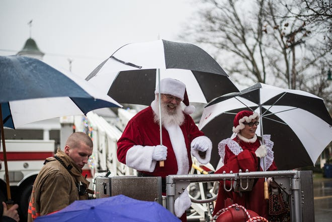 Santa and Mrs. Claus arrive by way of a Granville Township fire truck for last year's Christmas Candlelight Walking Tour.