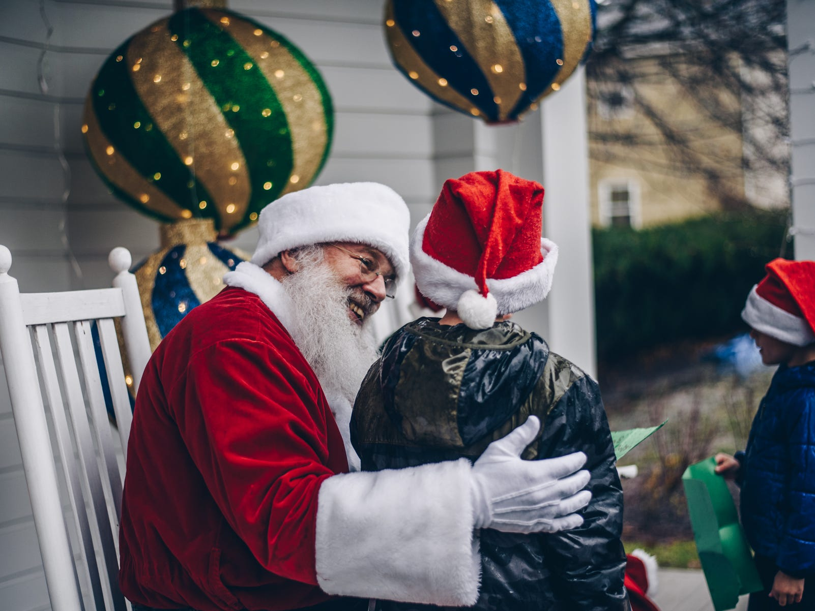 Santa and Mrs. Claus greeted young visitors and took Christmas wishes in the Knobel Folly behind Robbins Hunter Museum on Saturday.
