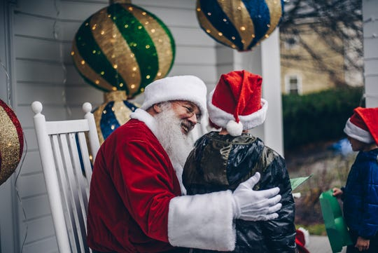 Santa and Mrs. Claus greeted young visitors and took Christmas wishes in the Knobel Folly behind Robbins Hunter Museum during last year's Christmas Candlelight Walking Tour.