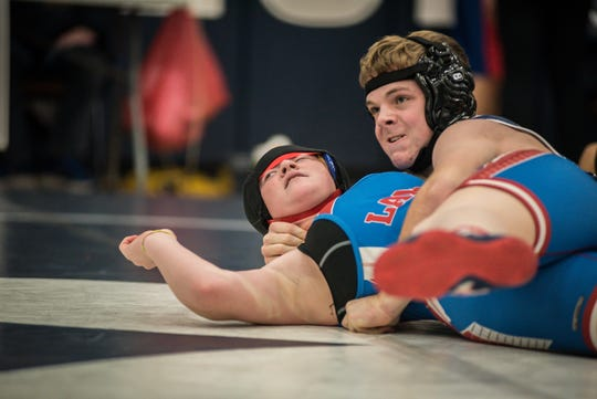 Granville's Andy Litle nears a pin of Lakewood's Shyanne Adkins in a 145-pound match Saturday during the Granville Invitational.
