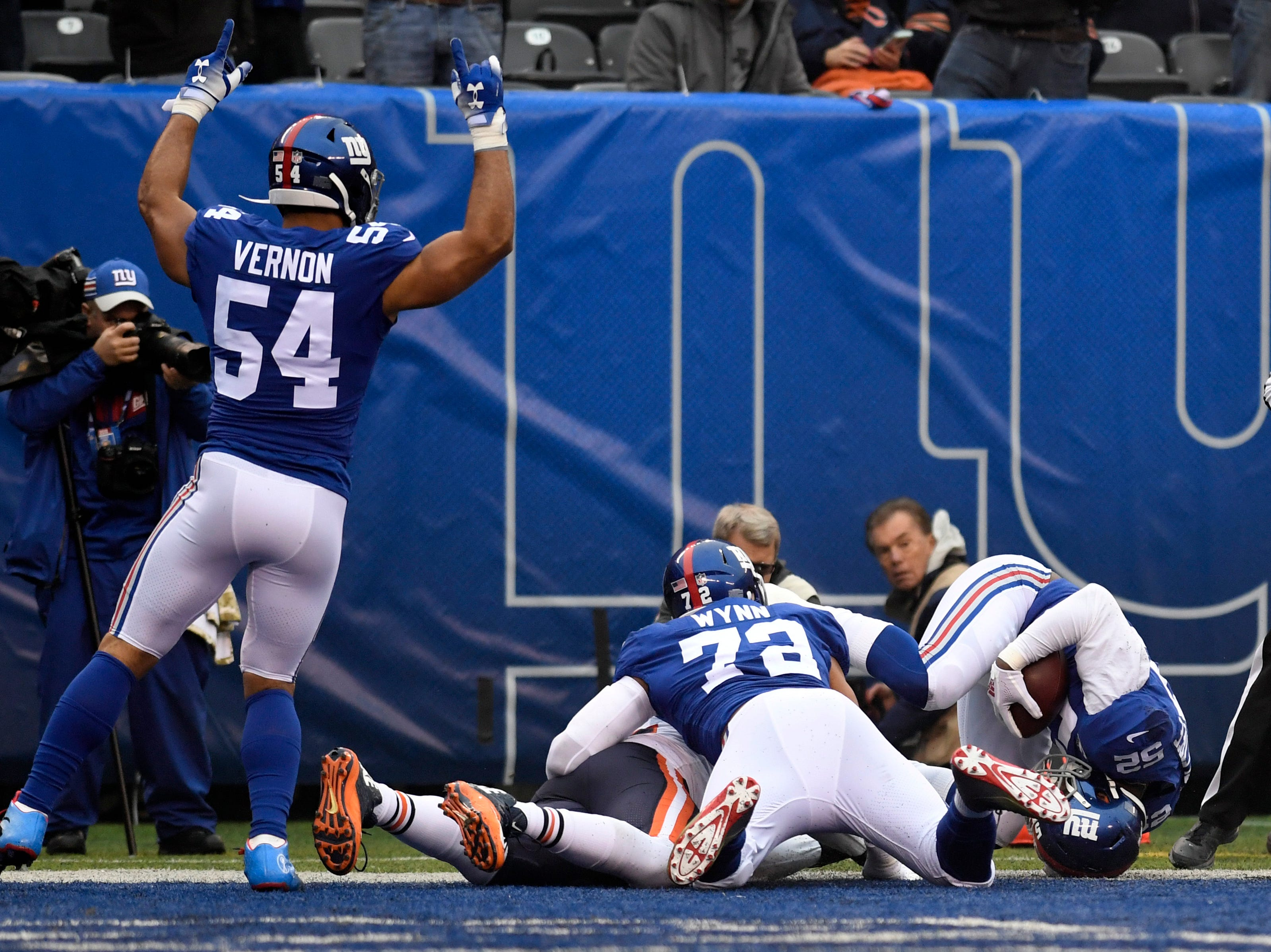 New York Giants linebacker Alec Ogletree, far right, rolls into the endzone for a touchdown after intercepting a Chicago Bears pass in the first quarter on Sunday, Dec. 2, 2018, in East Rutherford.