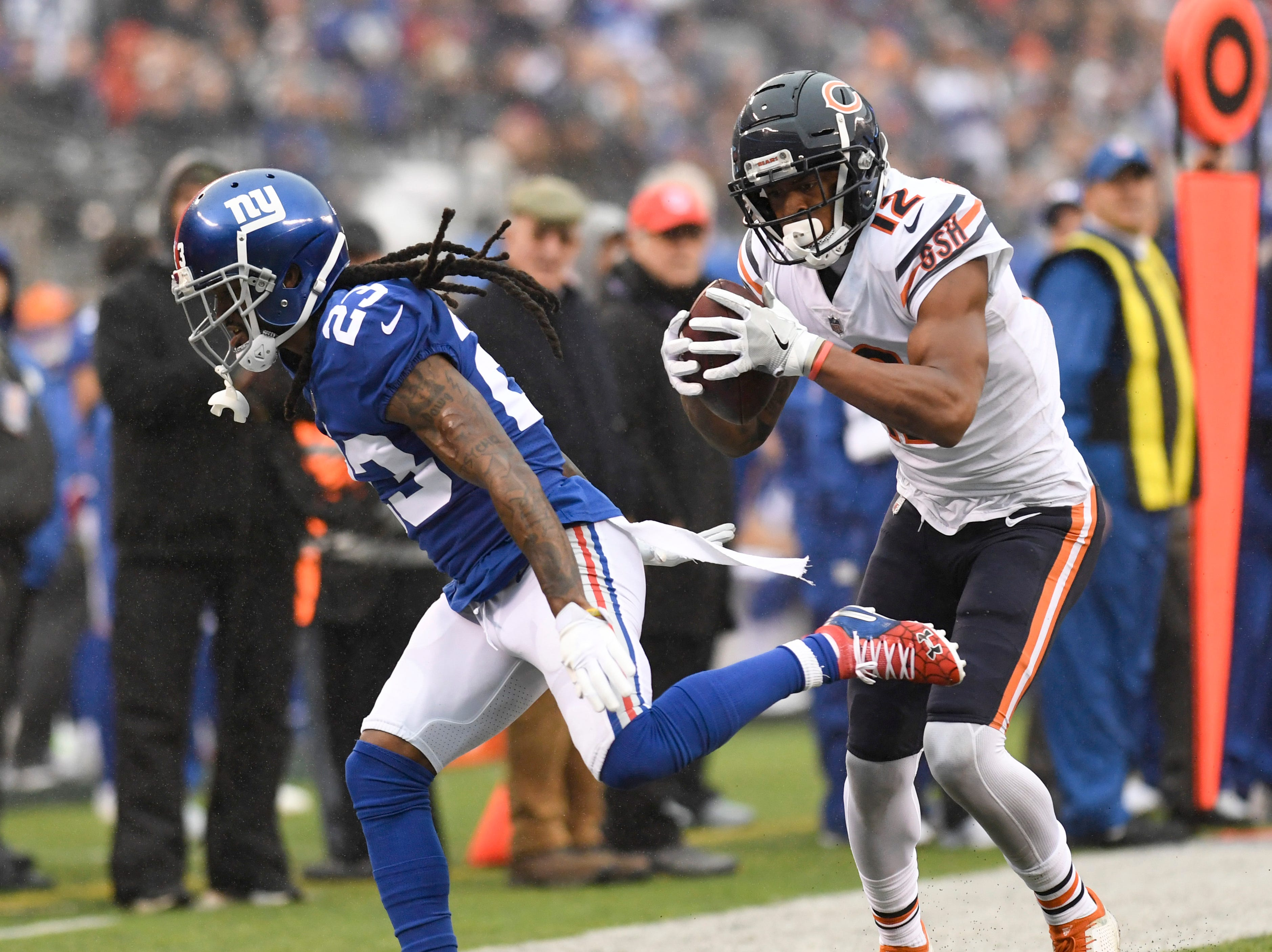 Chicago Bears wide receiver Allen Robinson (12) makes a catch over the head of New York Giants cornerback B.W. Webb (23) in the first half. The New York Giants face the Chicago Bears on Sunday, Dec. 2, 2018, in East Rutherford.