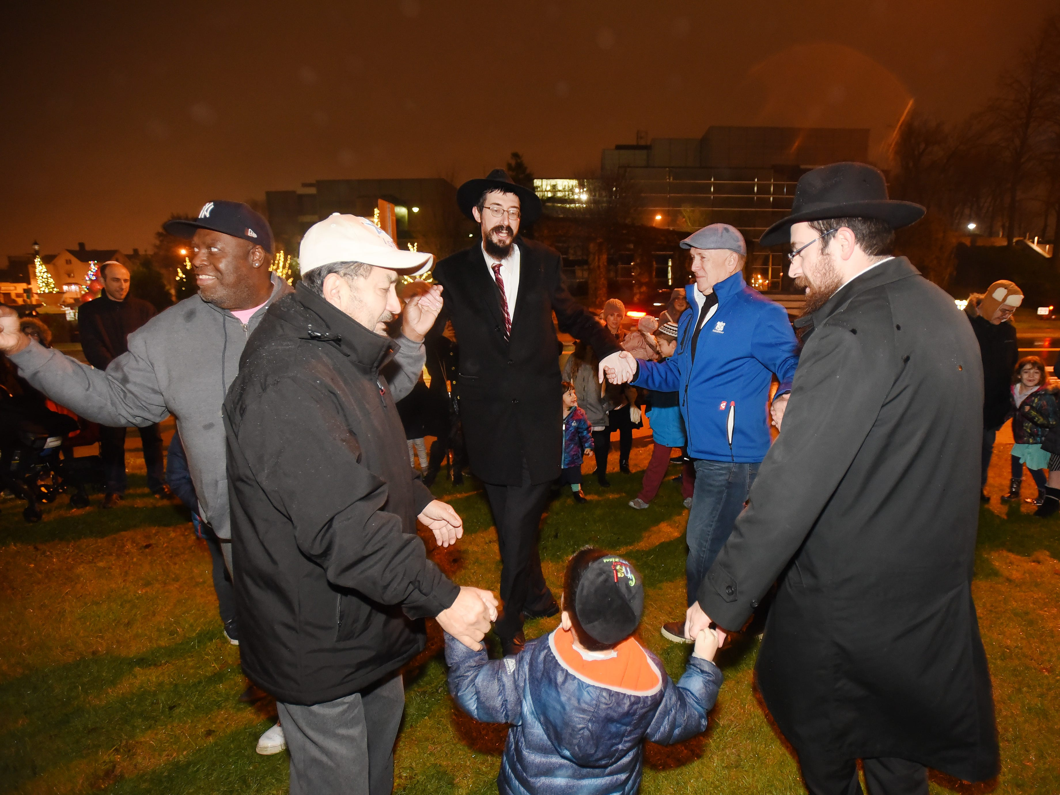 Rabbi Mendy Kaminker (center) from Chabad of Hackensack, Hackensack Mayor and Deputy Mayor and others, dance to celebrate the 2018 Hanukkah season following the lighting ceremony at the front lawn of Bergen County Courthouse in Hackensack on 12/02/18.