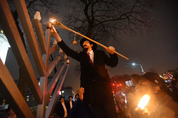 Rabbi Mendy Kaminker from Chabad of Hackensack, lights the Menorah    to celebrate the 2018 Hanukkah season during the lighting ceremony at the front lawn of Bergen County Courthouse in Hackensack on 12/02/18.