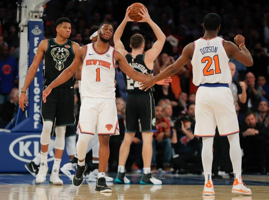 New York Knicks guard Emmanuel Mudiay (1) celebrates with guard Damyean Dotson (21) in overtime of an NBA basketball game against the Milwaukee Bucks, Saturday, Dec. 1, 2018, in New York. The Knicks won 136-134.