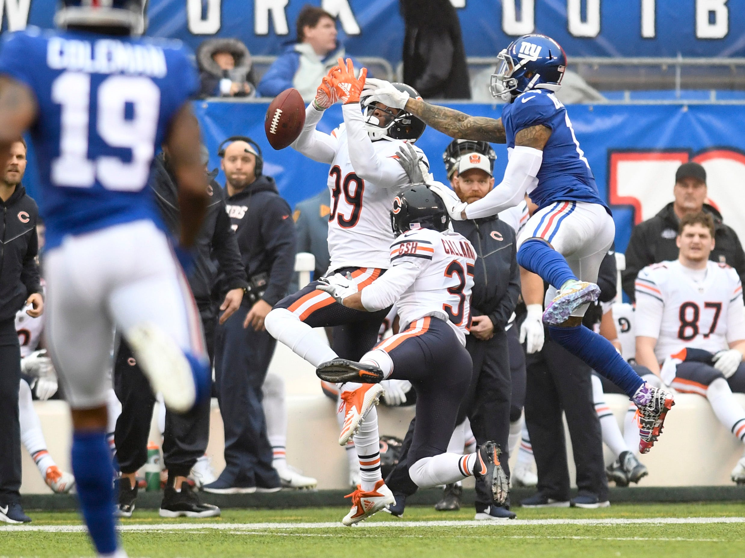 New York Giants wide receiver Odell Beckham Jr. (13) is nearly picked off by Chicago Bears safety Eddie Jackson (39) in the first half. The New York Giants face the Chicago Bears on Sunday, Dec. 2, 2018, in East Rutherford.