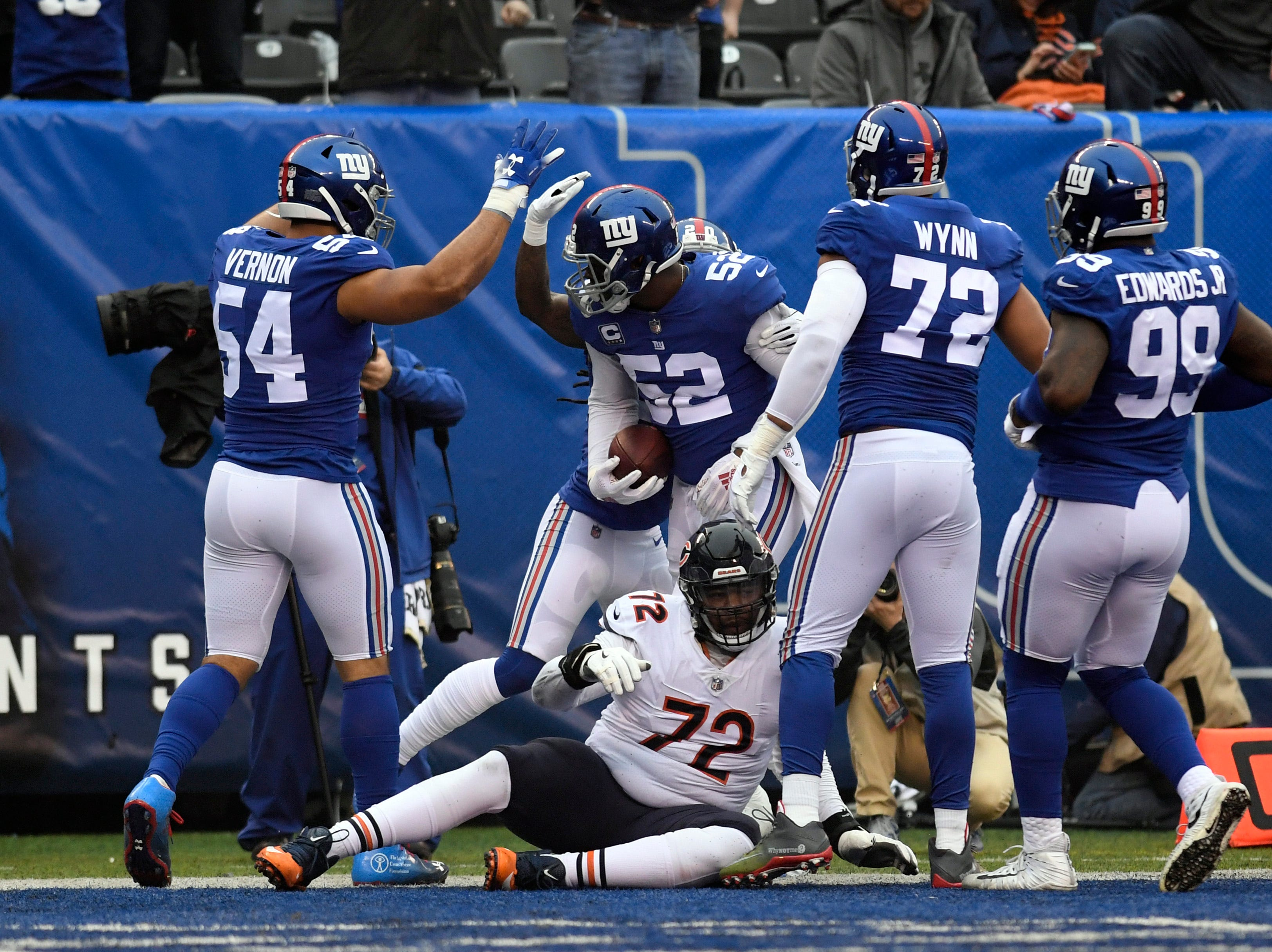 New York Giants linebacker Alec Ogletree (52) celebrates an interception returned for a touchdown in the first quarter. The New York Giants face the Chicago Bears on Sunday, Dec. 2, 2018, in East Rutherford.