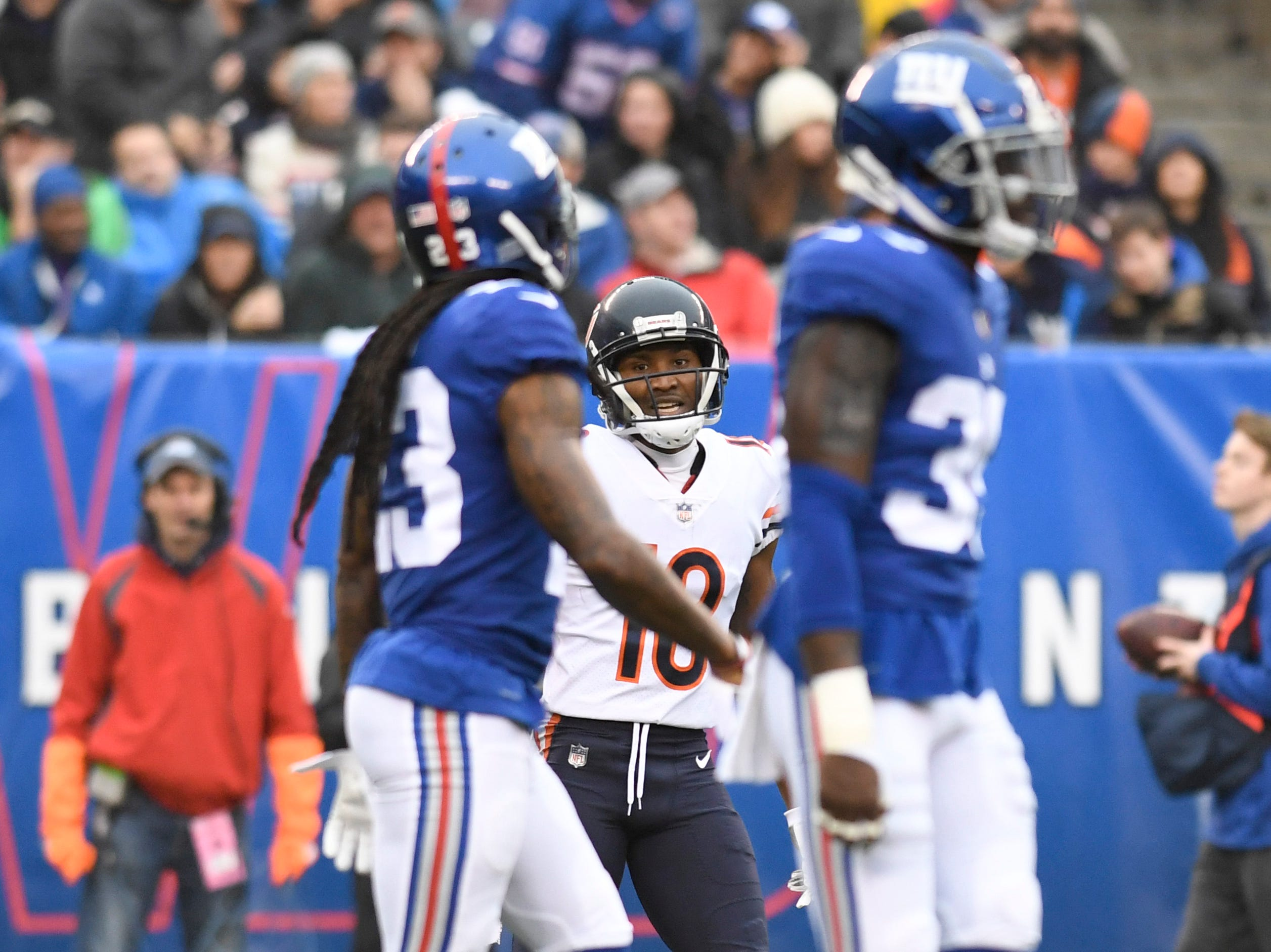 Chicago Bears wide receiver Taylor Gabriel (18) has words with New York Giants cornerbacks B.W. Webb, left, and Curtis Riley, right, after Riley nearly intercepts a pass intended for Gabriel in the first half. The New York Giants face the Chicago Bears on Sunday, Dec. 2, 2018, in East Rutherford.