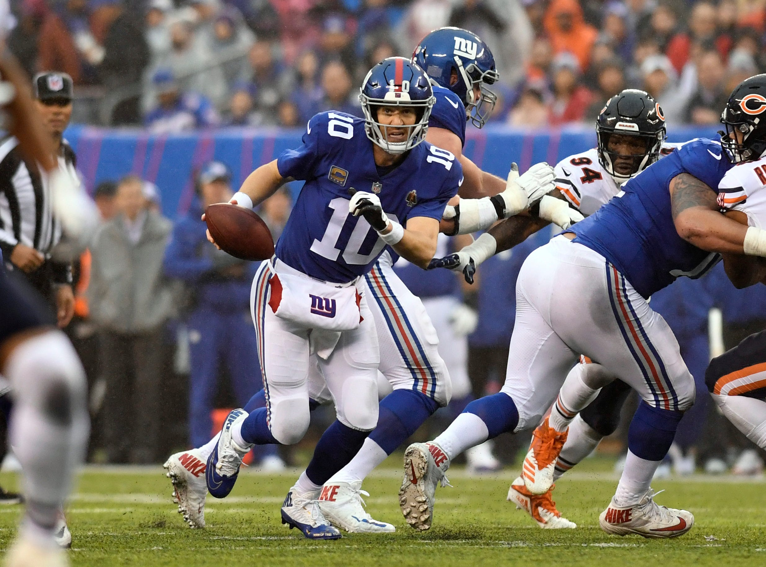 New York Giants quarterback Eli Manning (10) scrambles in the second half. The New York Giants defeat the Chicago Bears in overtime 30-27 on Sunday, Dec. 2, 2018, in East Rutherford.