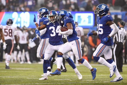New York Giants cornerback Grant Haley (34) and safety Sean Chandler, center, celebrate after Chandler recovers a Bears fumble in the second half. The New York Giants defeat the Chicago Bears in overtime 30-27 on Sunday, Dec. 2, 2018, in East Rutherford.
