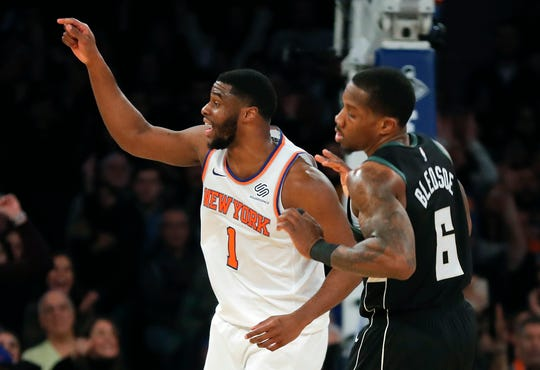 New York Knicks guard Emmanuel Mudiay (1) reacts after scoring against the Milwaukee Bucks during the fourth quarter of an NBA basketball game, Saturday, Dec. 1, 2018, in New York. The Knicks won 136-134 in overtime.
