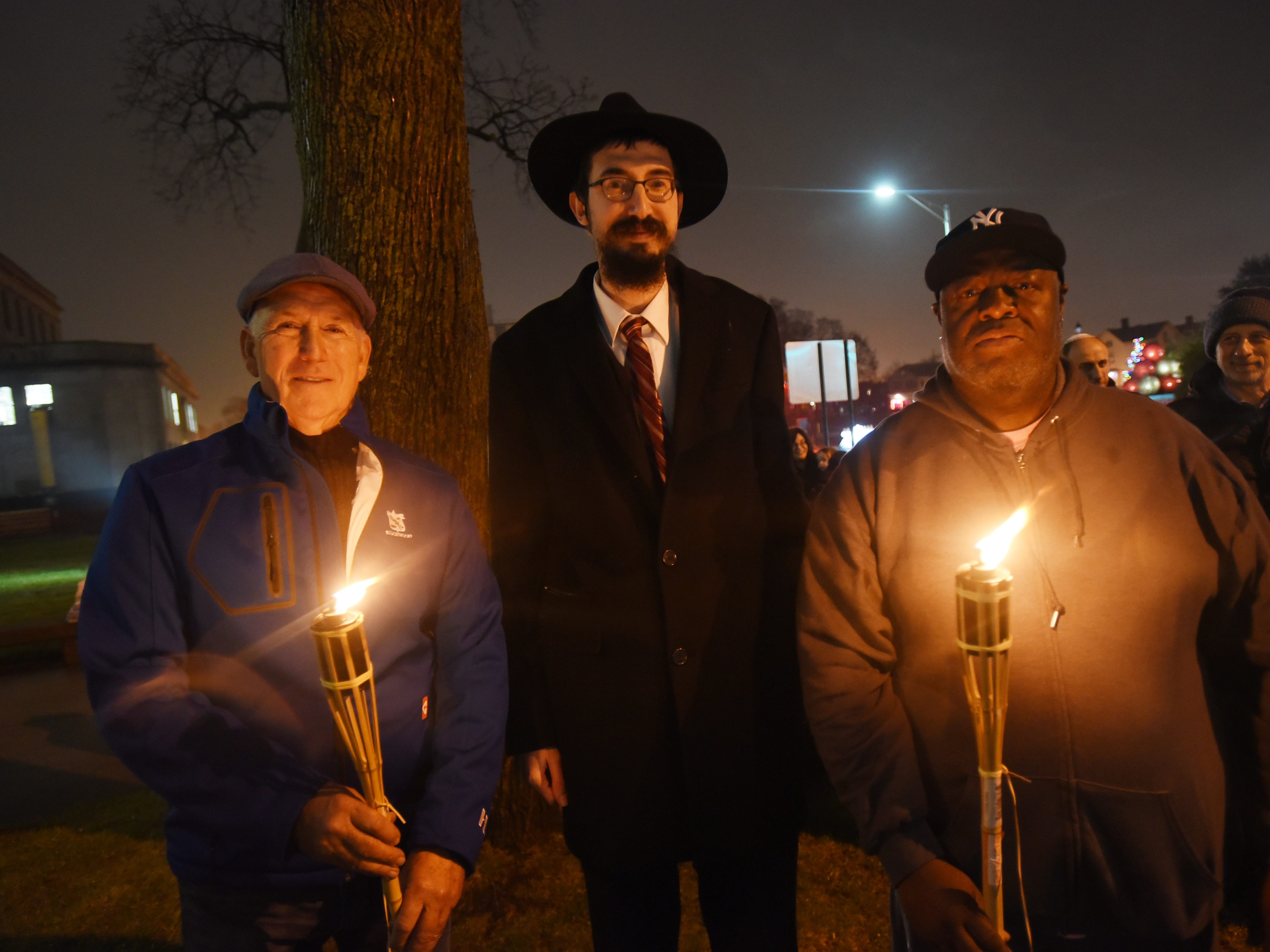 Rabbi Mendy Kaminker from Chabad of Hackensack, has a picture taken together with Hackensack Mayor John Labrosse (L) and Deputy Mayor David Sims (R) prior to the lighting ceremony at the front lawn of Bergen County Courthouse in Hackensack on 12/02/18.