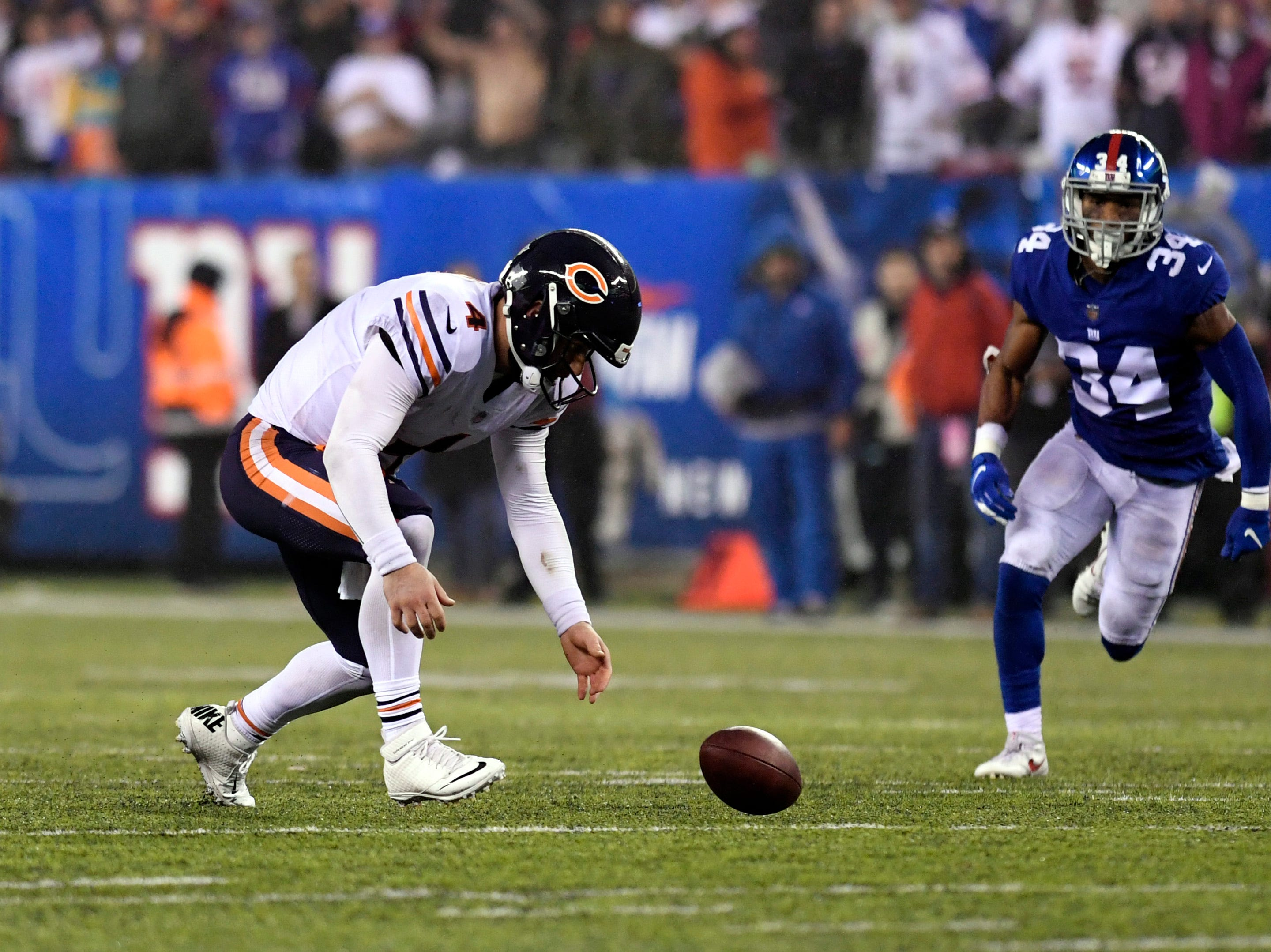 Chicago Bears quarterback Chase Daniel (4) fumbles the ball, but recovers before New York Giants cornerback Grant Haley (34) can get to it in the second half. The New York Giants defeat the Chicago Bears in overtime 30-27 on Sunday, Dec. 2, 2018, in East Rutherford.