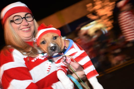 Good Karma dog rescue marches during the 'Home for the Holidays' parade in Westwood on Saturday December 1, 2018.