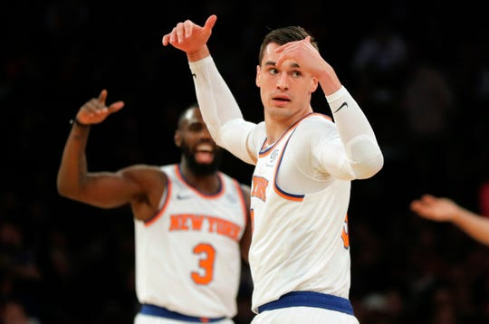 New York Knicks forward Mario Hezonja (8) reacts after hitting a 3-point shot against the Milwaukee Bucks during the first quarter of an NBA basketball game, Saturday, Dec. 1, 2018, in New York. The Knicks won 136-134 in overtime.