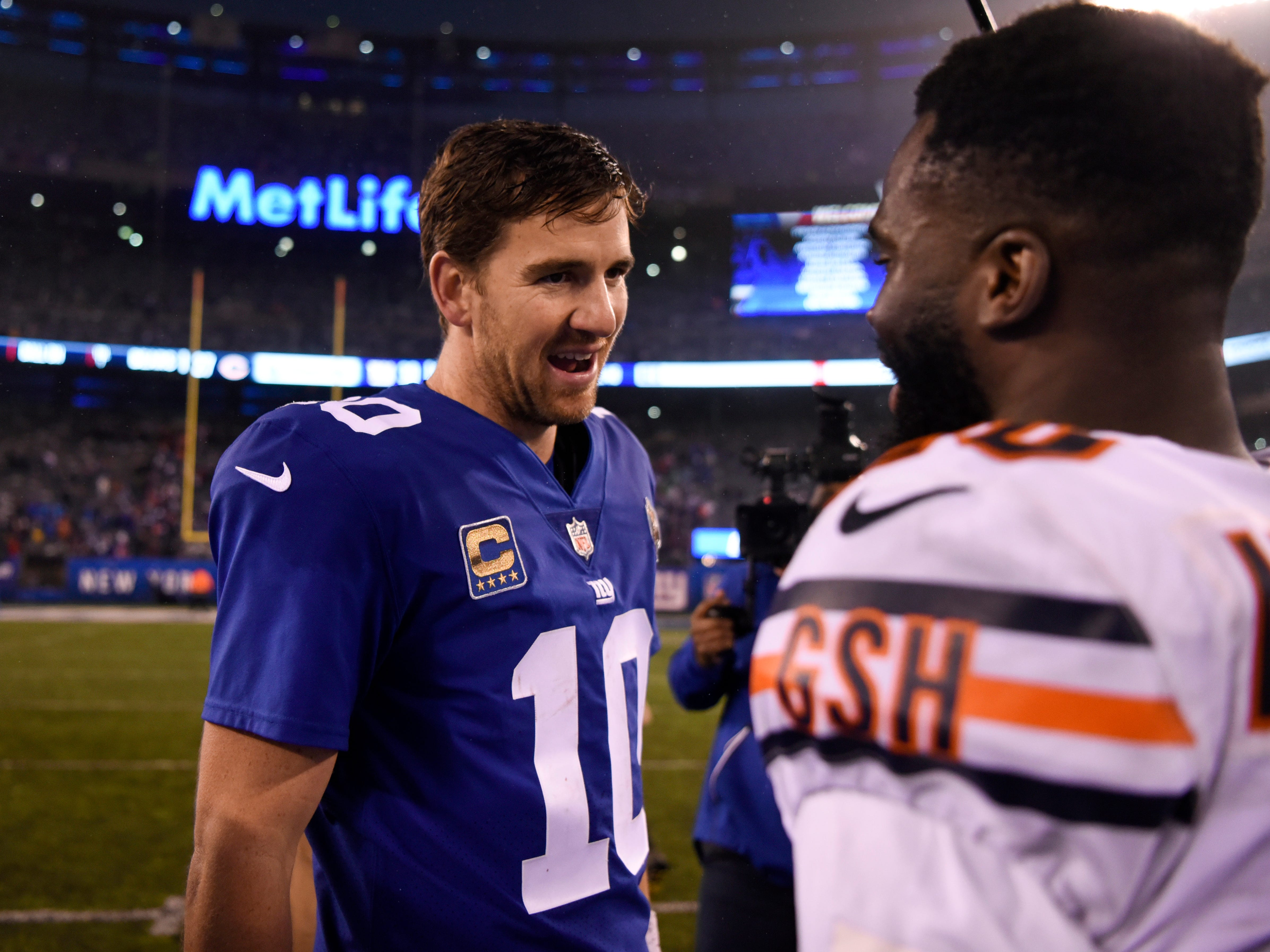 New York Giants quarterback Eli Manning (10) talks to former teammate Chicago Bears cornerback Prince Amukamara (20) after the game. The New York Giants defeat the Chicago Bears in overtime 30-27 on Sunday, Dec. 2, 2018, in East Rutherford.
