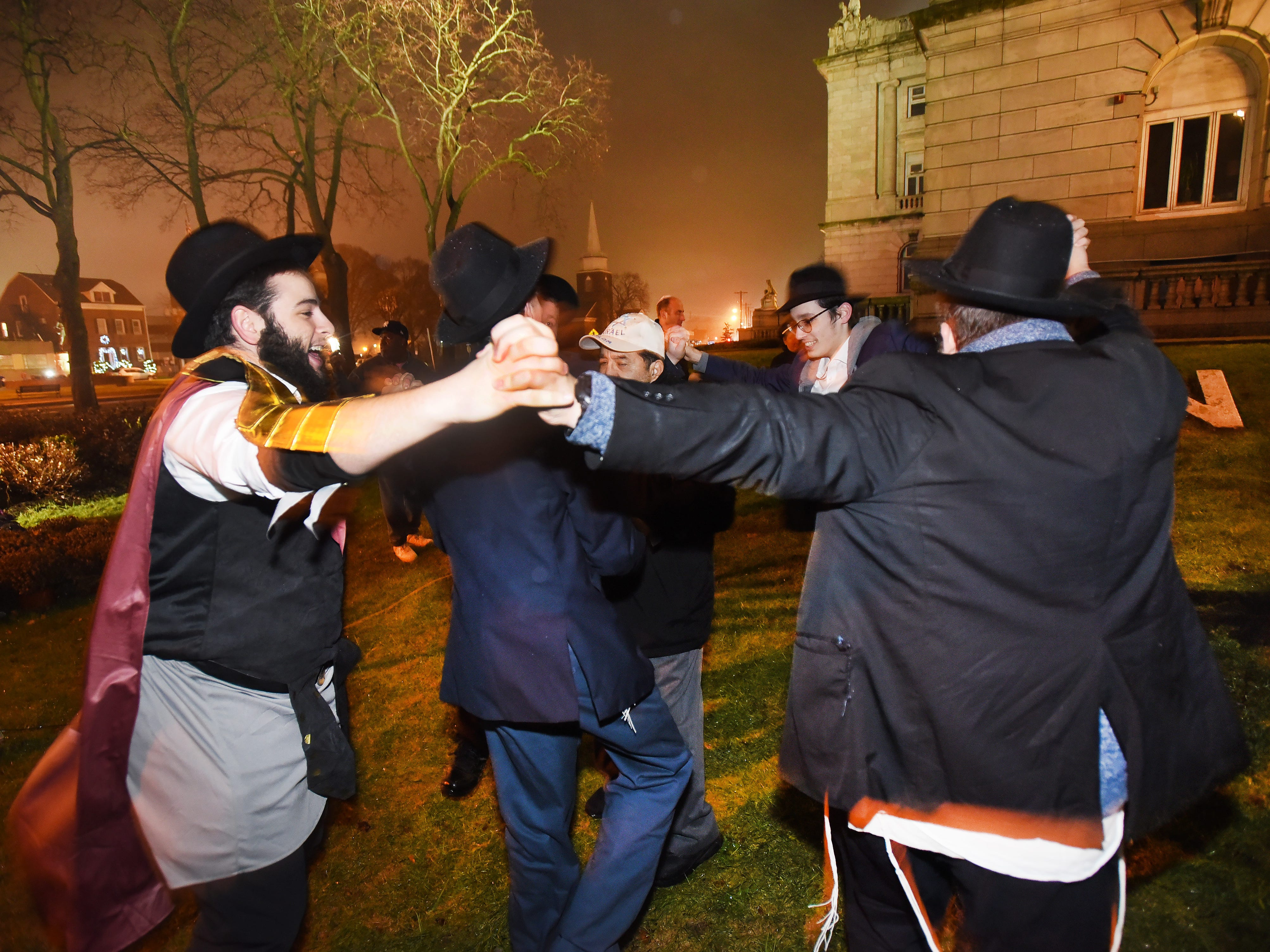 Members from Chabad of Hackensack, dance to celebrate the 2018 Hanukkah season following the lighting ceremony at the front lawn of Bergen County Courthouse in Hackensack on 12/02/18.
