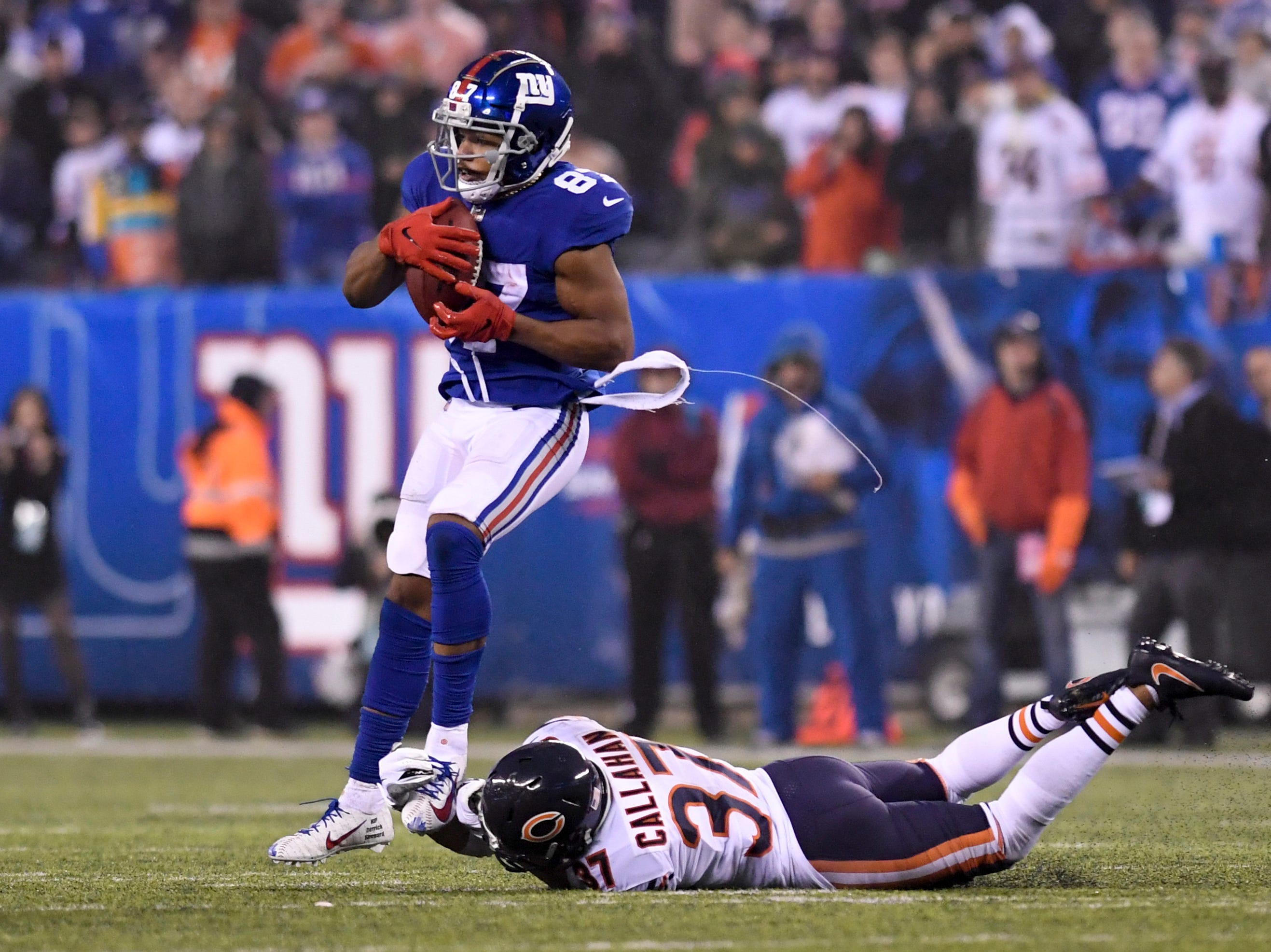 New York Giants wide receiver Sterling Shepard (87) makes a catch over Chicago Bears cornerback Bryce Callahan (37) in the second half. The New York Giants defeat the Chicago Bears in overtime 30-27 on Sunday, Dec. 2, 2018, in East Rutherford.