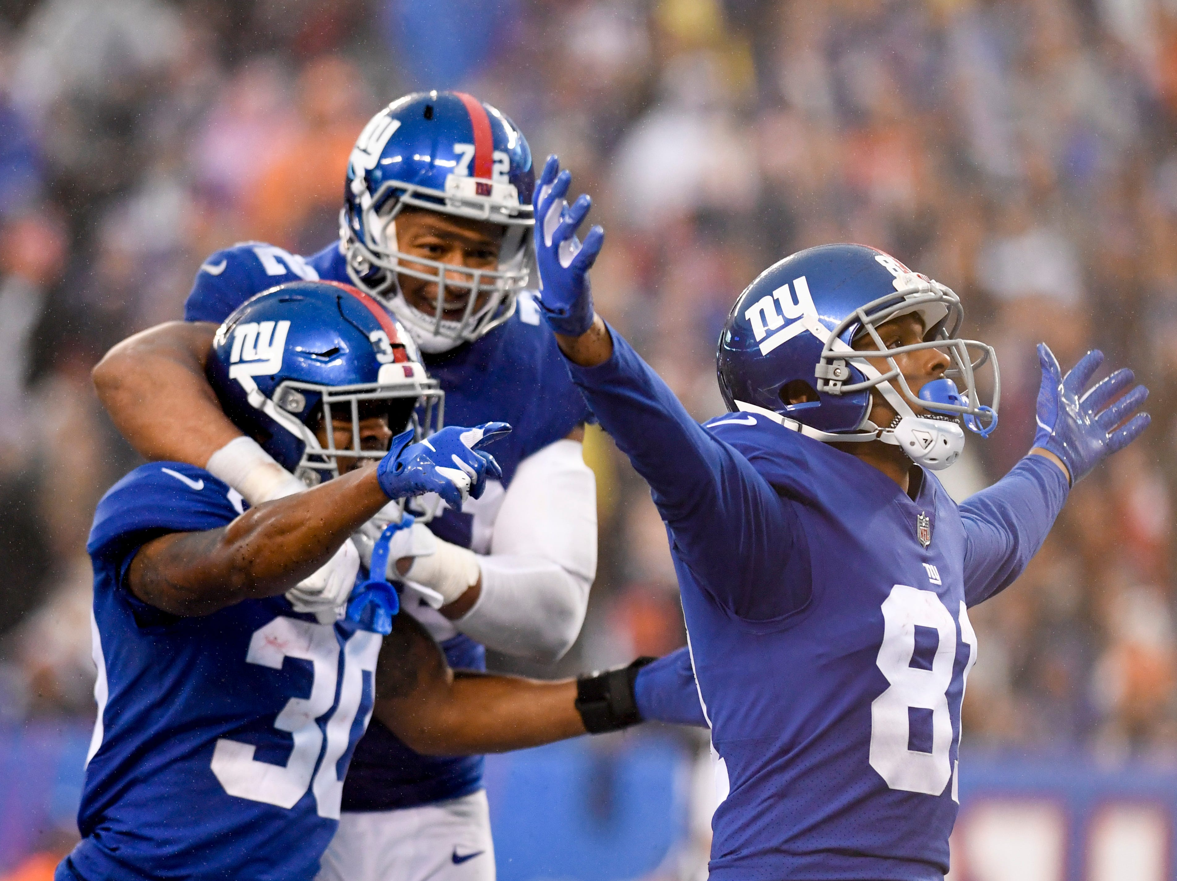New York Giants wide receiver Russell Shepard (81), cornerback Antonio Hamilton (30), and defensive end Kerry Wynn (72) celebrate a special teams play putting the Chicago Bears on their own one-yard-line in the second half. The New York Giants defeat the Chicago Bears in overtime 30-27 on Sunday, Dec. 2, 2018, in East Rutherford.