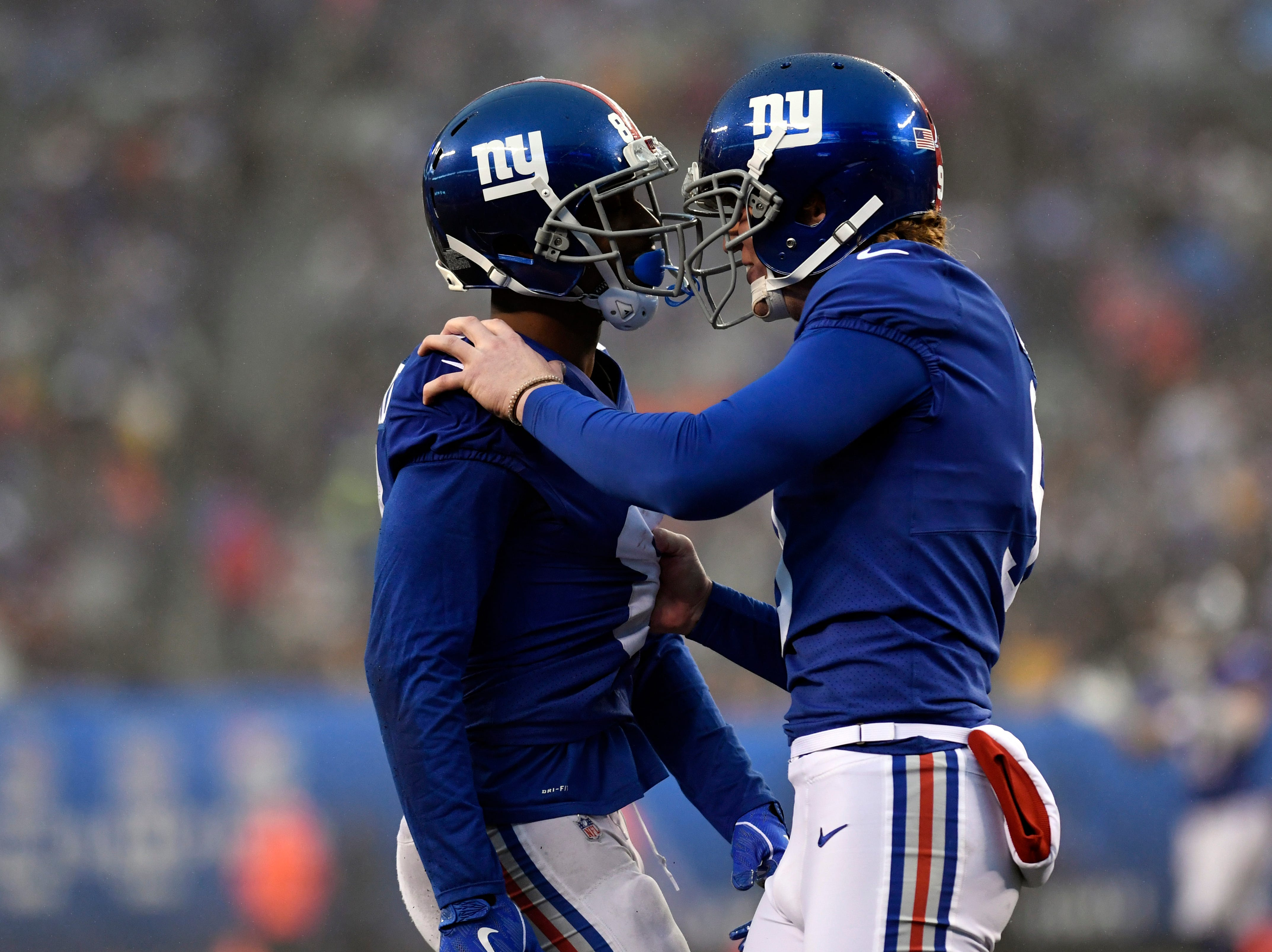 New York Giants wide receiver Russell Shepard, left, and punter Riley Dixon, right, celebrate after a special teams play putting the Chicago Bears at their own first yard line. The New York Giants defeat the Chicago Bears in overtime 30-27 on Sunday, Dec. 2, 2018, in East Rutherford.