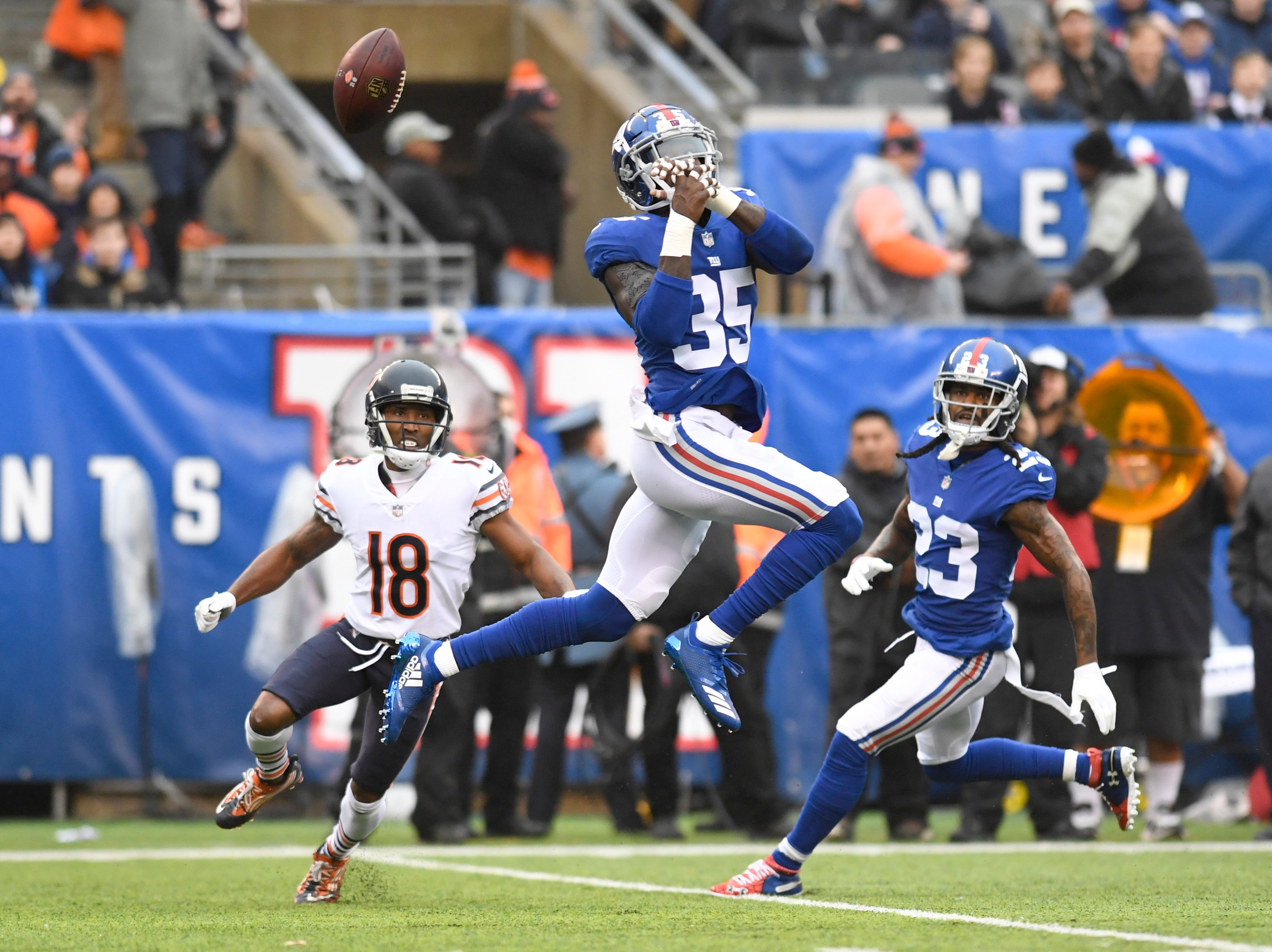 New York Giants cornerback Curtis Riley (35) nearly intercepts a pass intended for Chicago Bears wide receiver Taylor Gabriel (18) in the first half on Sunday, Dec. 2, 2018, in East Rutherford.