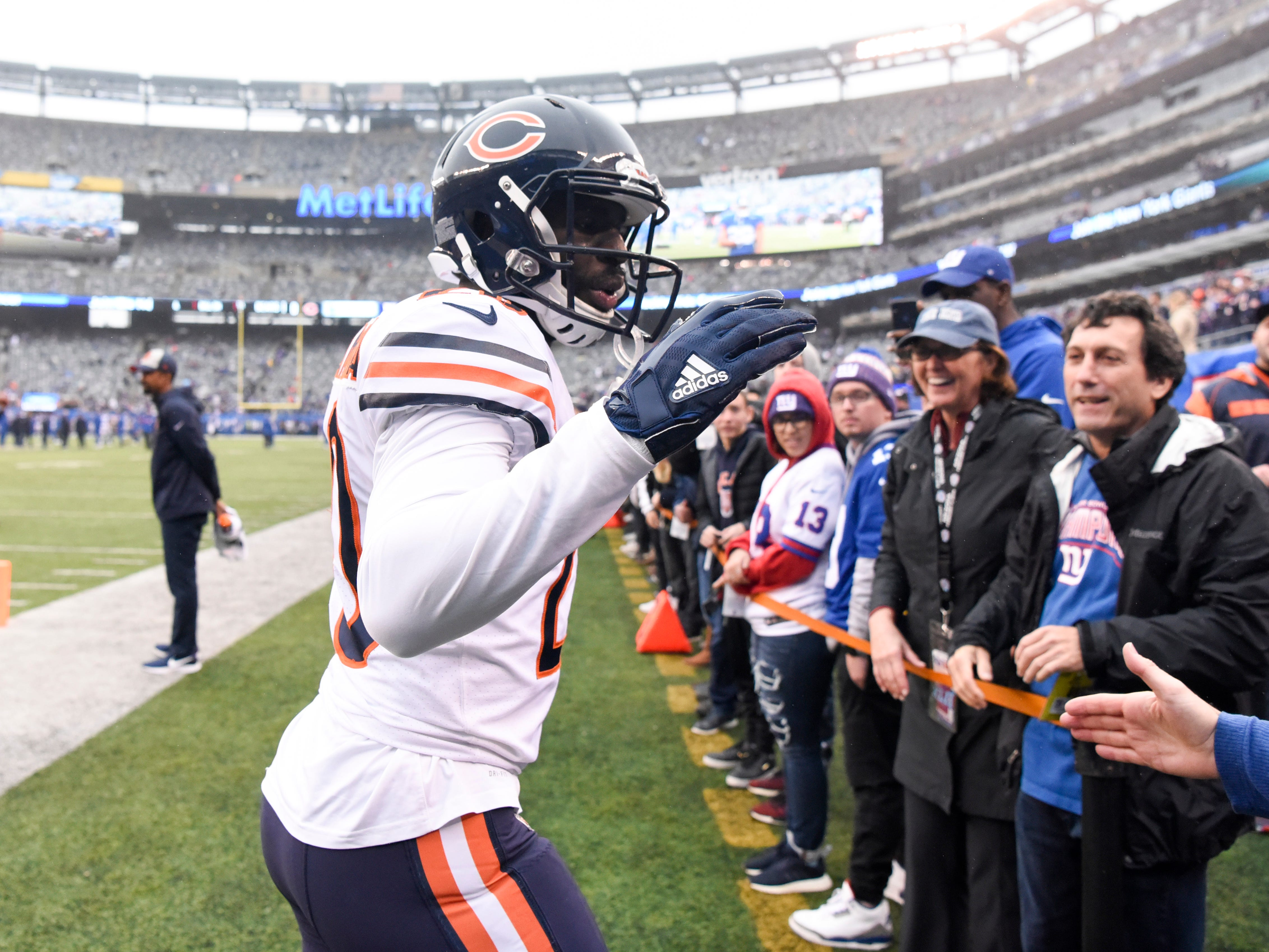 Chicago Bears cornerback Prince Amukamara (20) high-fives Giants fans on his return to MetLife Stadium. The New York Giants face the Chicago Bears on Sunday, Dec. 2, 2018, in East Rutherford.