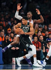 Milwaukee Bucks forward Giannis Antetokounmpo (34) drives against New York Knicks forward Noah Vonleh (32) during the second quarter of an NBA basketball game, Saturday, Dec. 1, 2018, in New York.