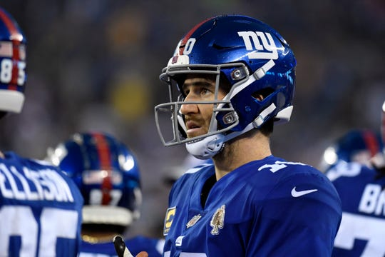 New York Giants quarterback Eli Manning (10) watches from the sideline as the Chicago Bears tie the score, sending the game into overtime. The New York Giants defeat the Chicago Bears in overtime 30-27 on Sunday, Dec. 2, 2018, in East Rutherford.
