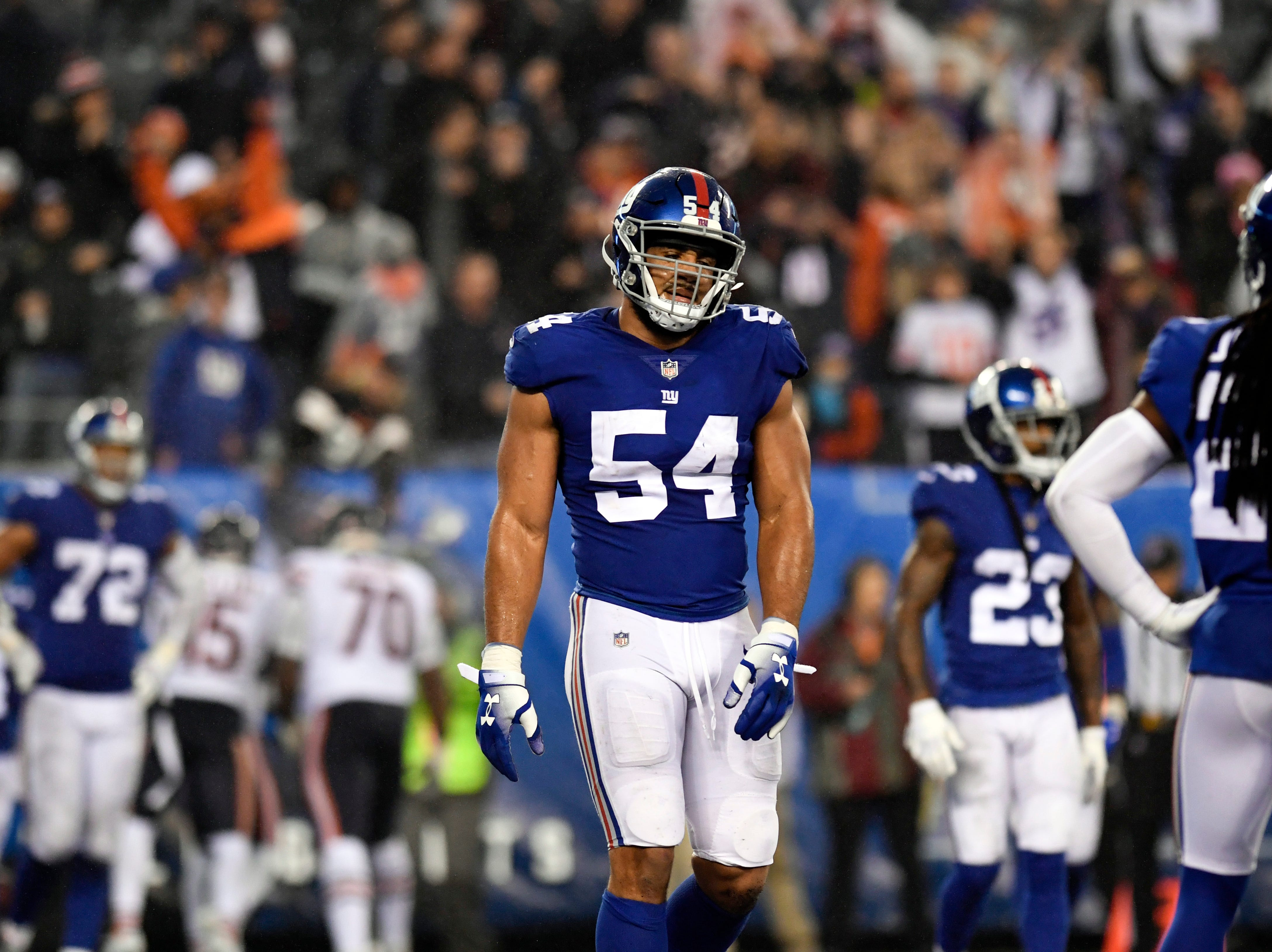 New York Giants linebacker Olivier Vernon (54) reacts as the Giants allow the Bears to score a touchdown, sending the game into overtime. The New York Giants defeat the Chicago Bears in overtime 30-27 on Sunday, Dec. 2, 2018, in East Rutherford.