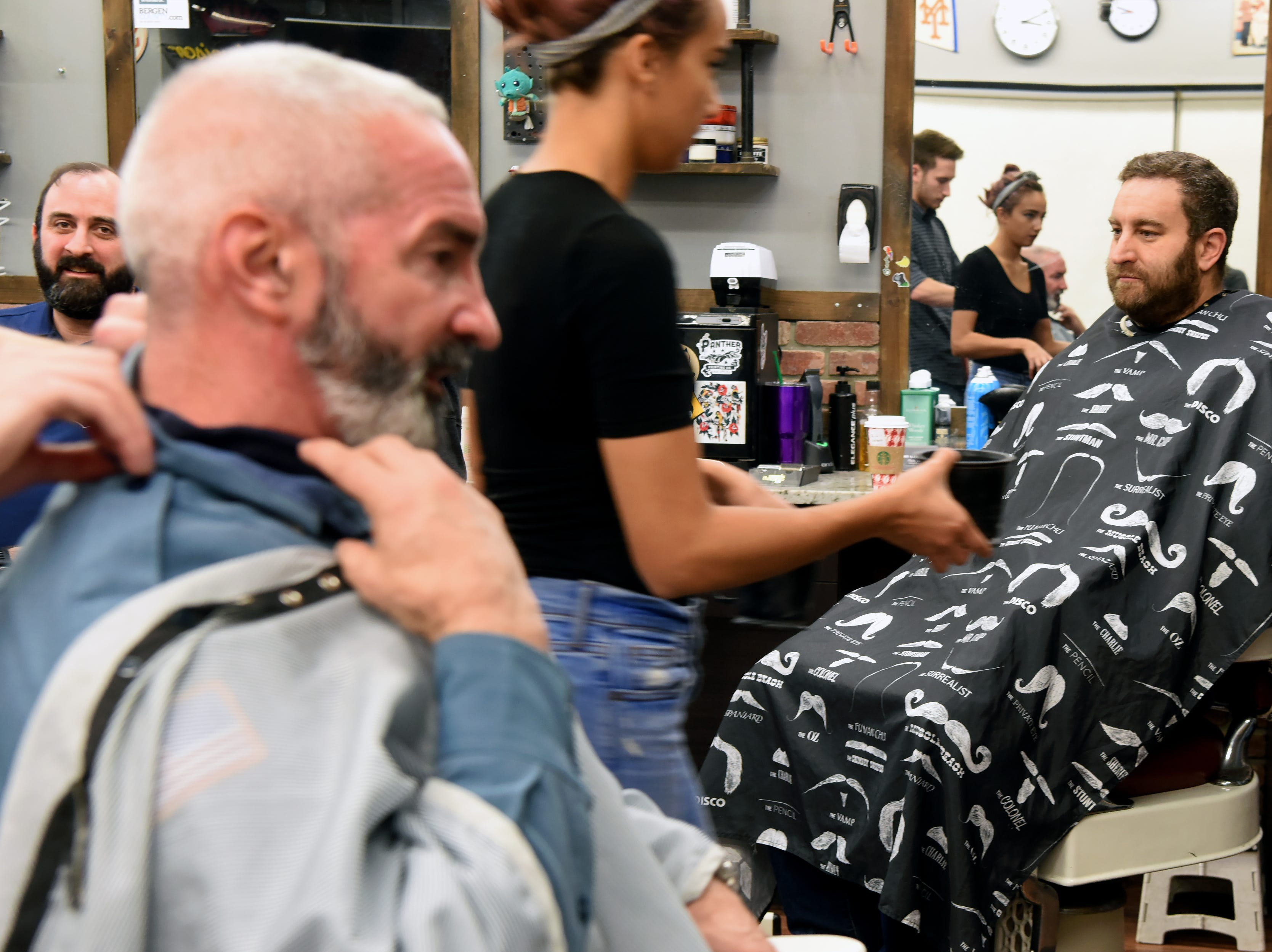 The Ridgewood, Wyckoff and Franklin Lakes PBAs held their No-Shave November Annual Shave-Off at Iconic Barber Shop in Glen Rock on Sunday, December 2, 2018. The money raised will help a Ridgewood family pay medical bills. Iconic Barber Shop also donated 100% percent of the proceeds from Sunday morning's Shave-Off.