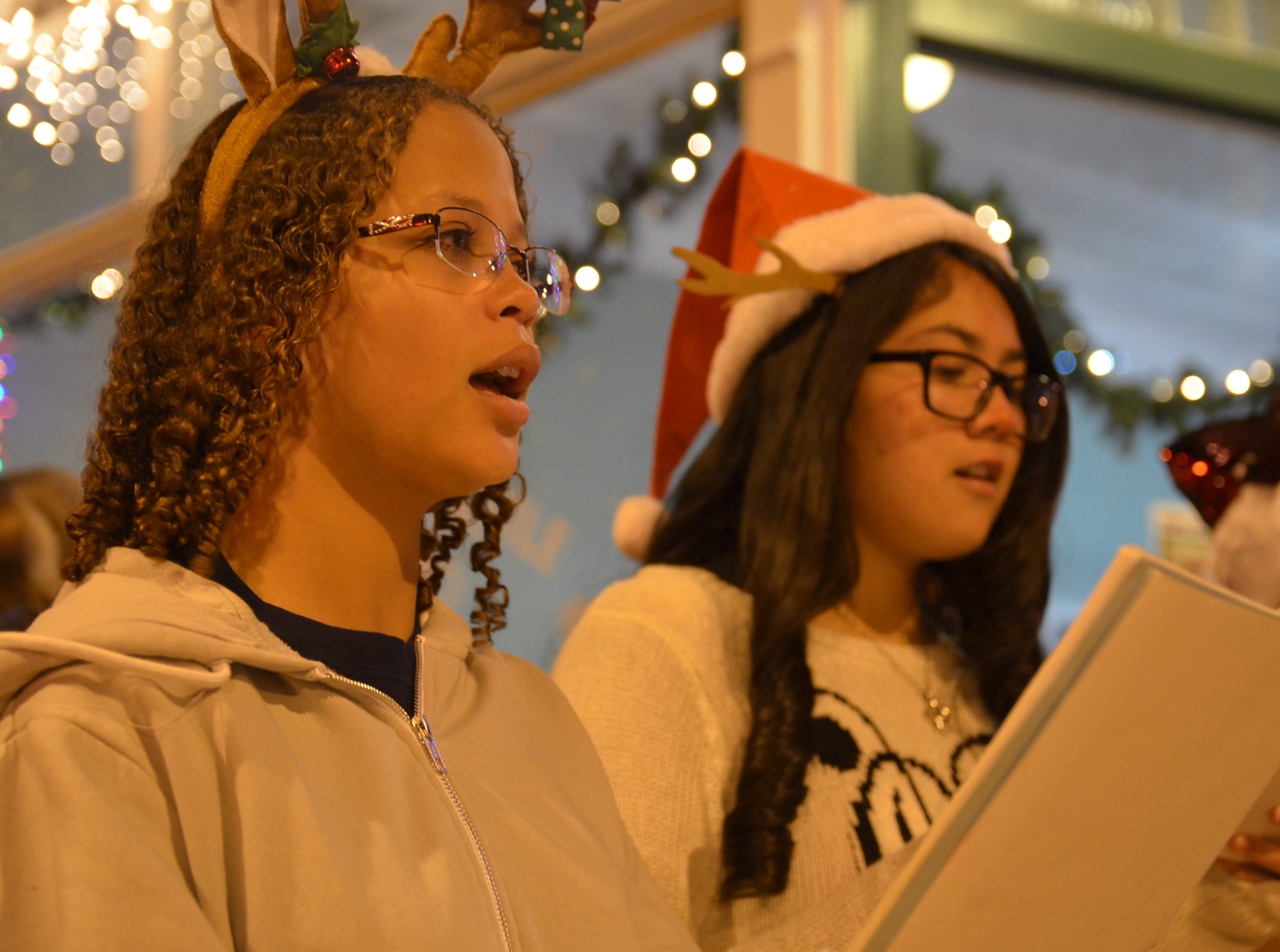 At left, Shyann Carr, 17 and Victoria Ramirez, 16, both DHS junior choir students.