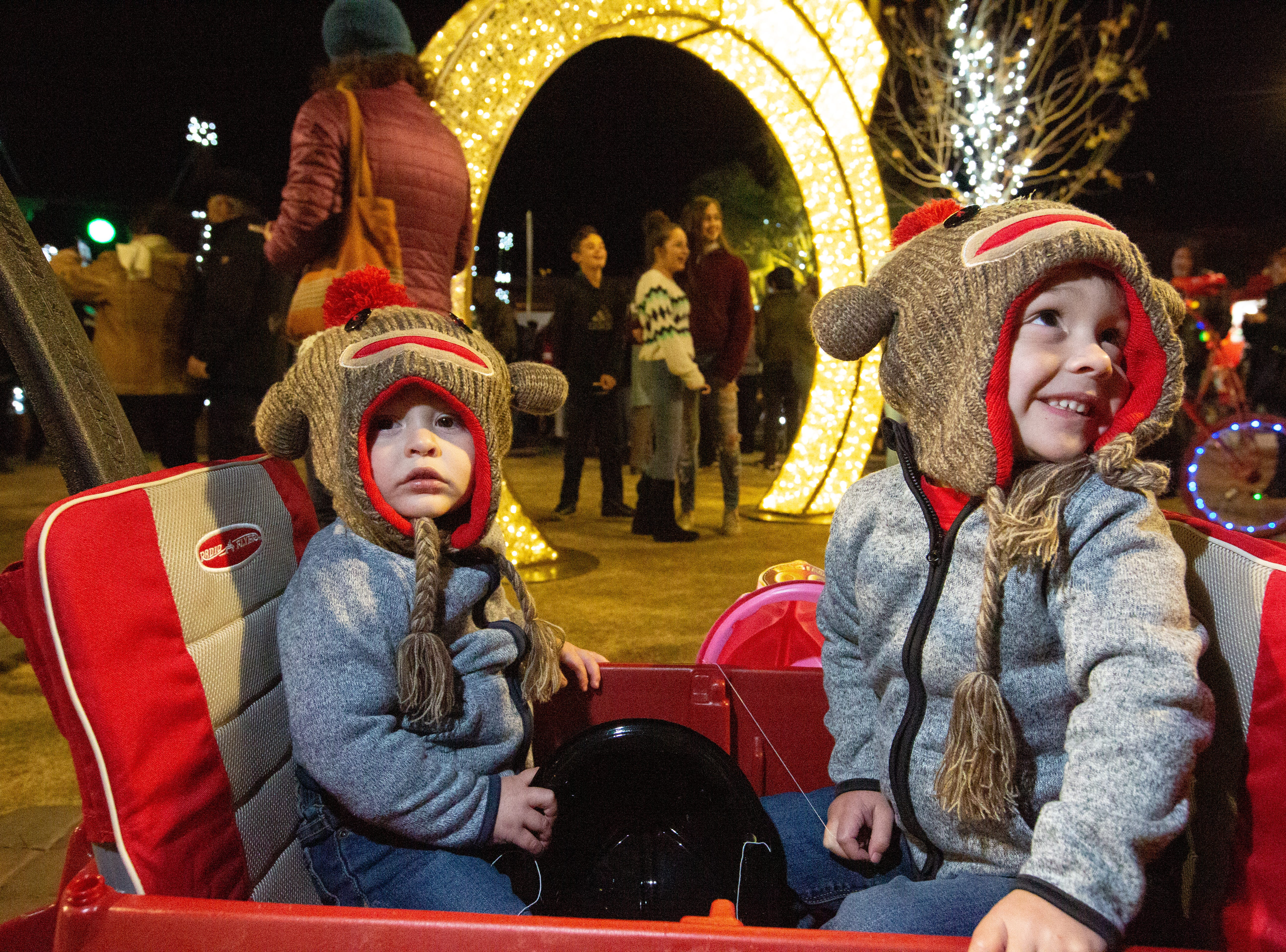 Parker Cuenca, left, 15 months, and his brother Tanner, 3, attend The Christmas in Cruces Tree Lighting Extravaganza on Saturday, Dec. 1, 2018 at the Plaza de Las Cruces.