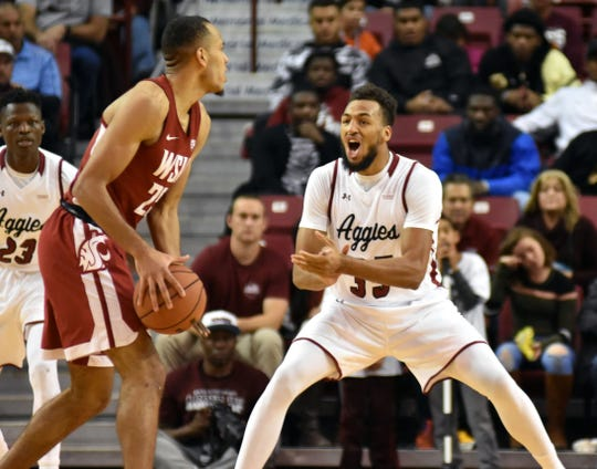 New Mexico State's Johnny McCants gets the defense going against the Washingston State Cougars in the Pan Am on Saturday night.