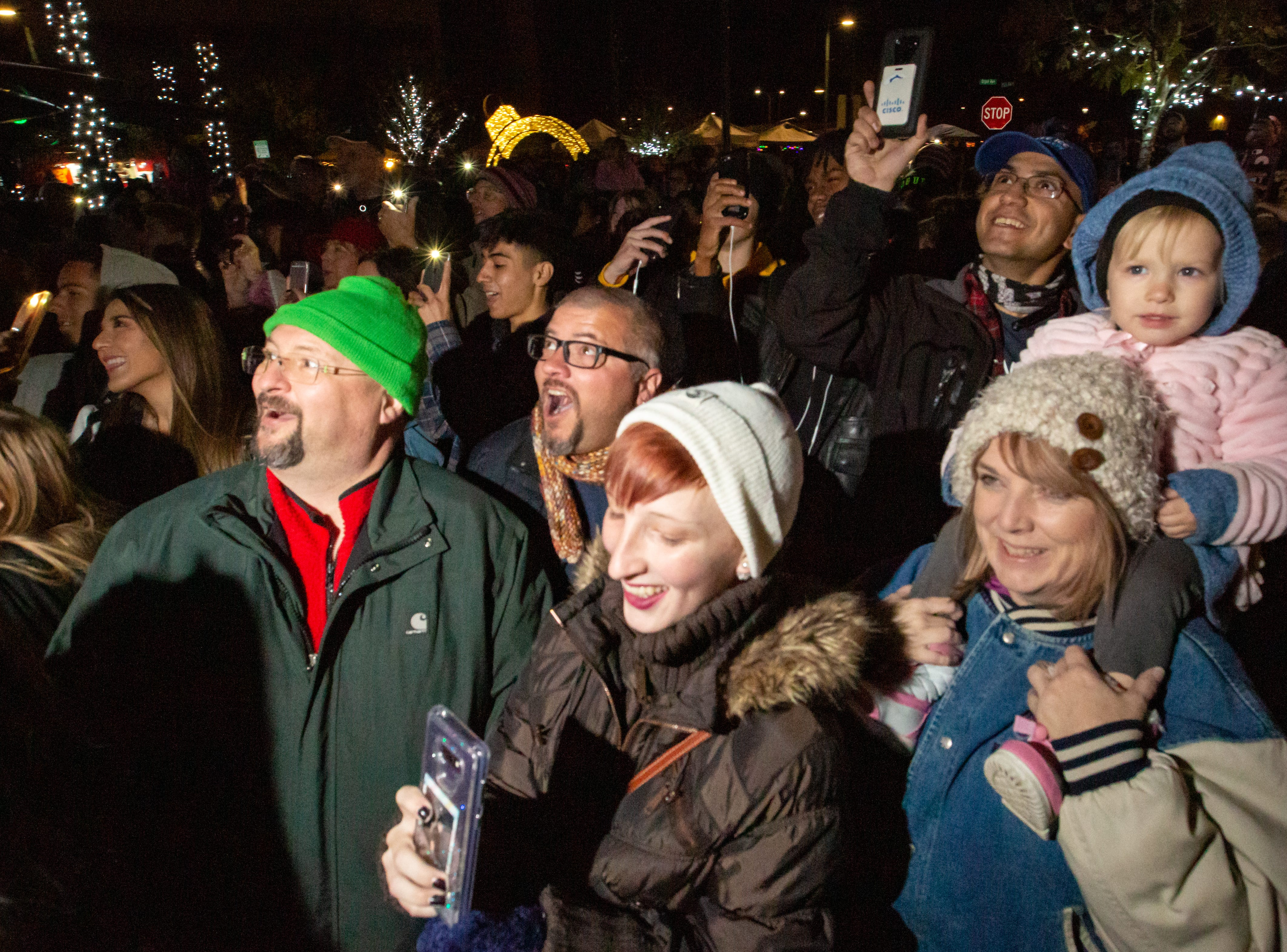 The crowd reacts as the lights atop the tree are turned on during The Christmas in Cruces Tree Lighting Extravaganza on Saturday, Dec. 1, 2018.