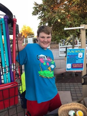 Tannon Christensen sells a variety of items at his business, The Fun House, such as marshmallow shooters, scented play dough and stress balls.