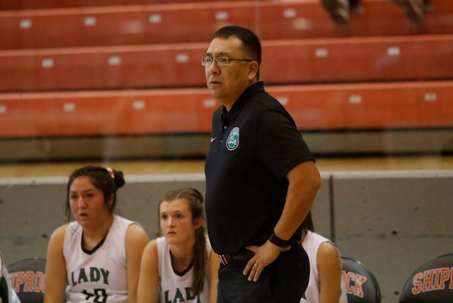 Farmington girls basketball coach Larenson Henderson watches his team on the floor against Whitehorse, Utah during the Jerry Richardson Memorial tournament Thursday at Shiprock. Visit daily-times.com to see the latest sports results, photo galleries and video highlights.