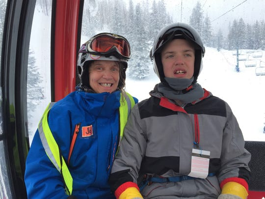 Ready to take a turn at skiing, this young boy was able to experience skiing thanks to his coach and the Ski Apache Adaptive Ski Program.