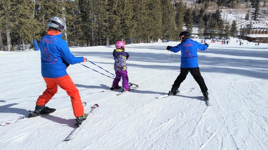 Coaches use tethers to help the skiers during their runs acclimating them to the feel of being on skis and going down the slopes. The tethers act as a breaking and guidance device. Once the coaches are able to create slack, the skier is usually ready to take a run without the aid of tethering. but are always accompanied by coaches.