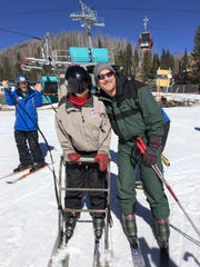Shelby takes a turn skiing at the Ski Apache Adaptive Ski Program which offers snowboarding and skiing for the physically and developmentally disabled.