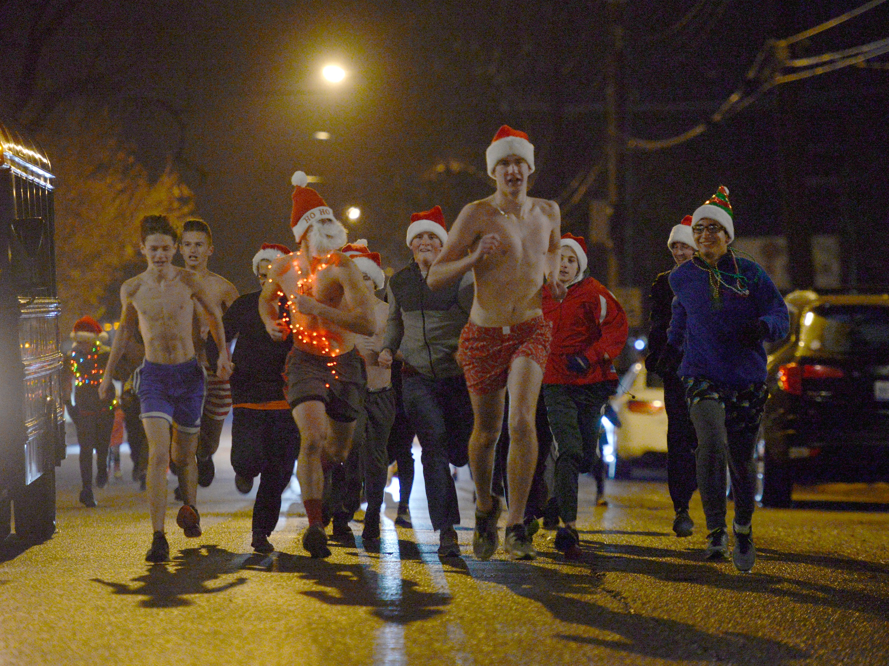 Runners in the Cool Yule fun run just before the start of the Lighted Parade Dec. 1, 2018.