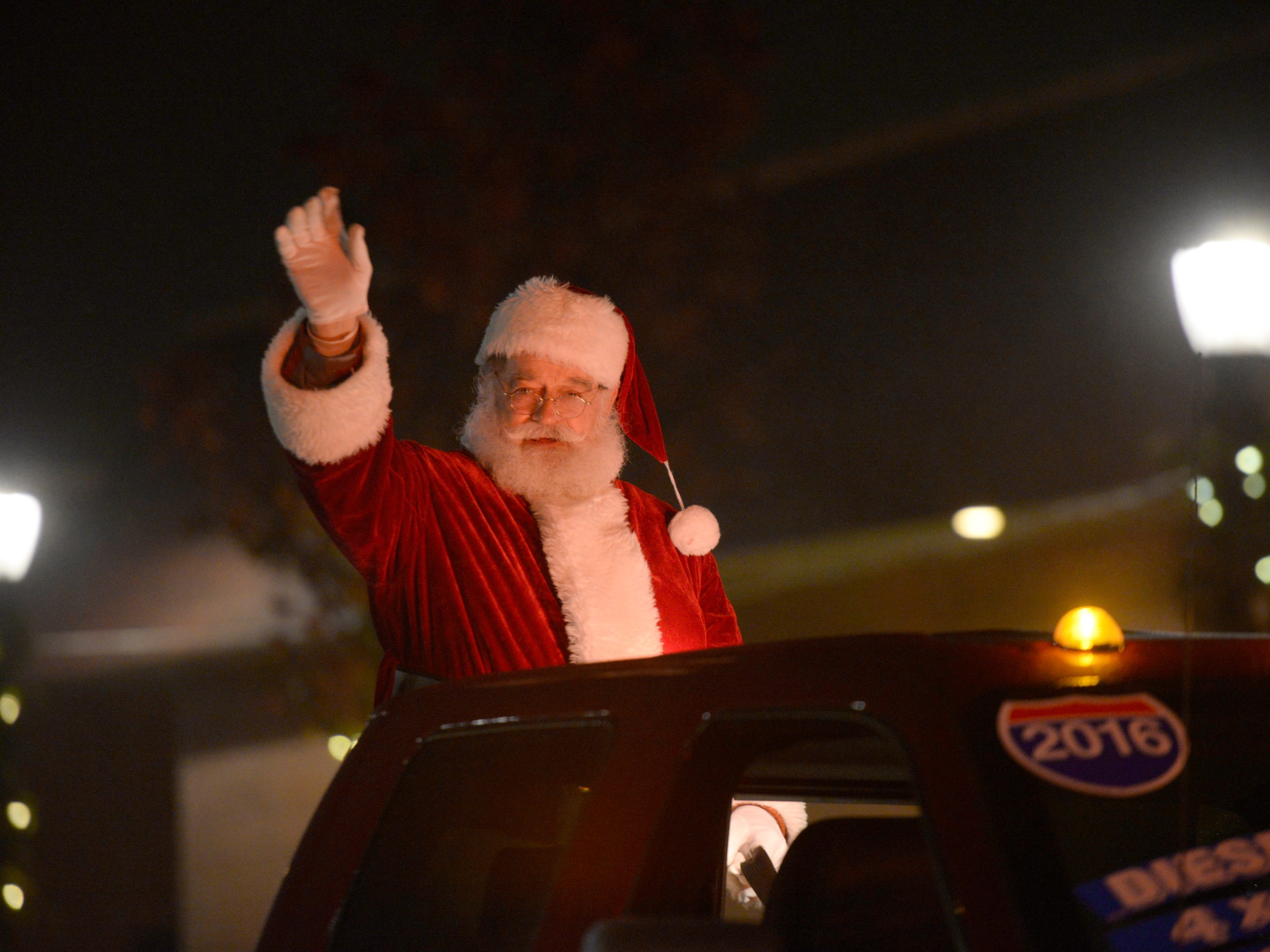 The Big Guy makes his appearance during the Lighted Parade as part of South Lyon's Cool Yule celebration Dec. 1, 2018.