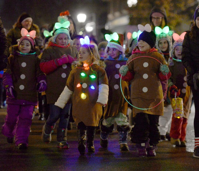 Girl Scouts march in the Lighted Parade during Cool Yule celebration Dec. 1, 2018.