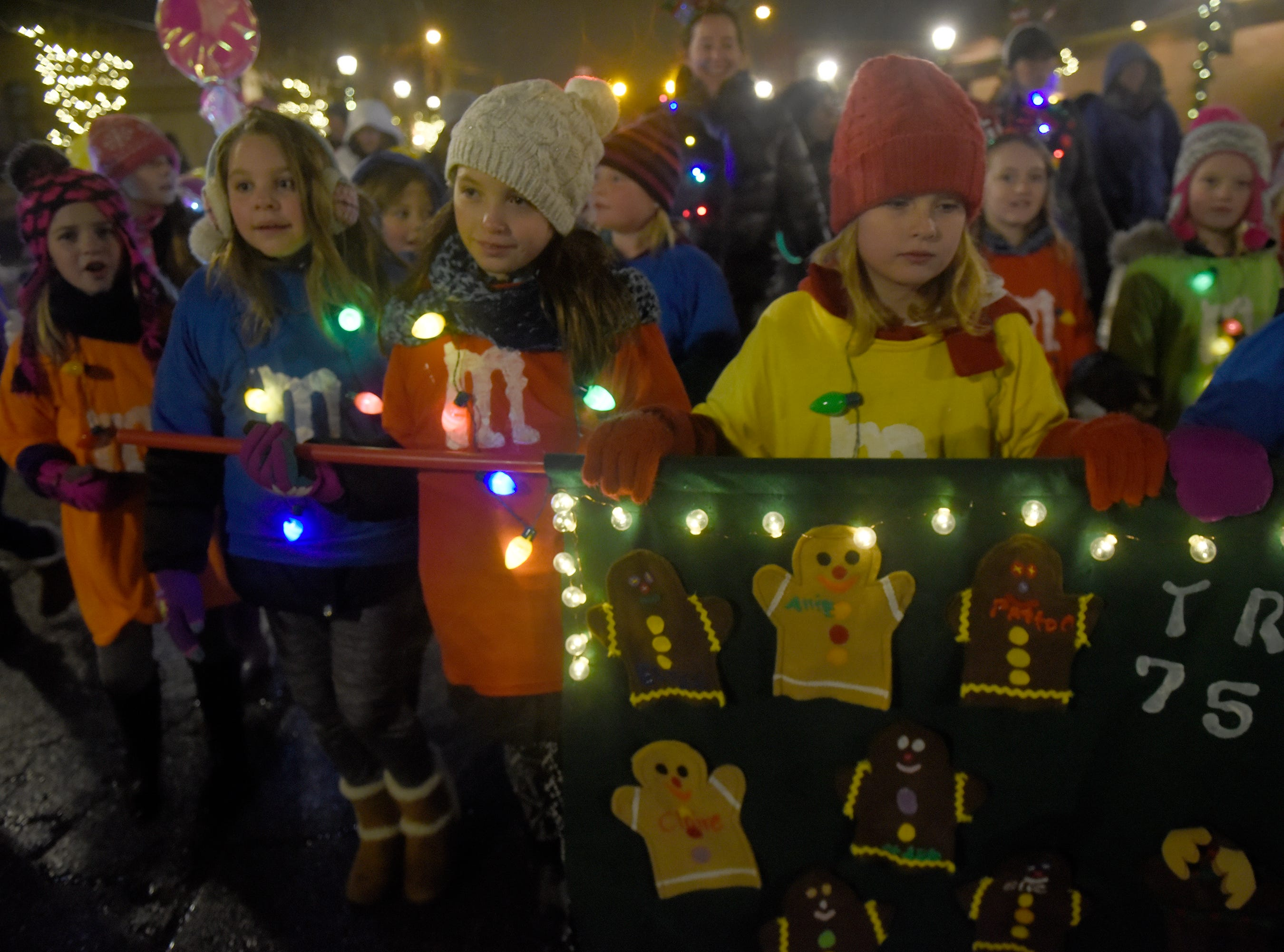 Girl Scouts during the Lighted Parade at South Lyon's Cool Yule celebration Dec. 1, 2018.