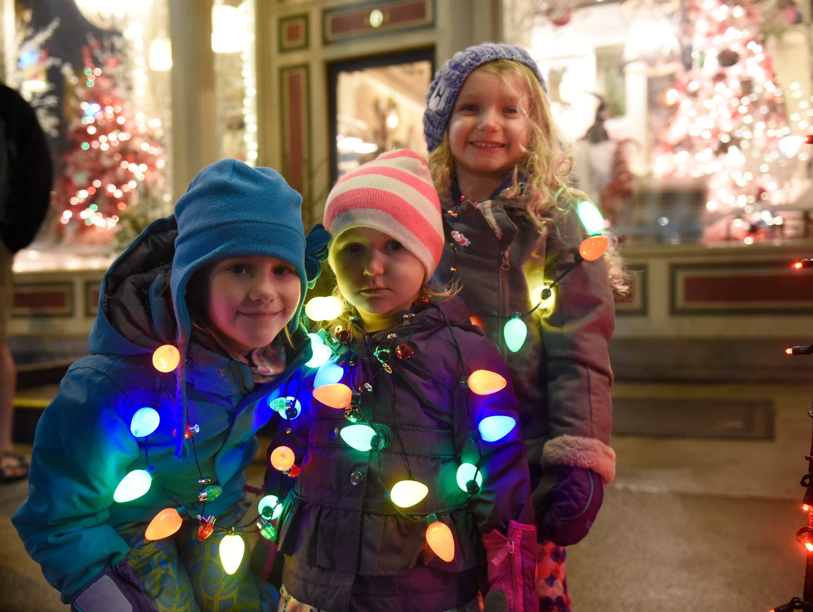 Anna, 5, (left) and Mia, 2, Fontecchio along with Jillian Tratechaud, 6, are ready for the start of South Lyon's Cool Yule Lighted Parade Dec. 1, 2018.
