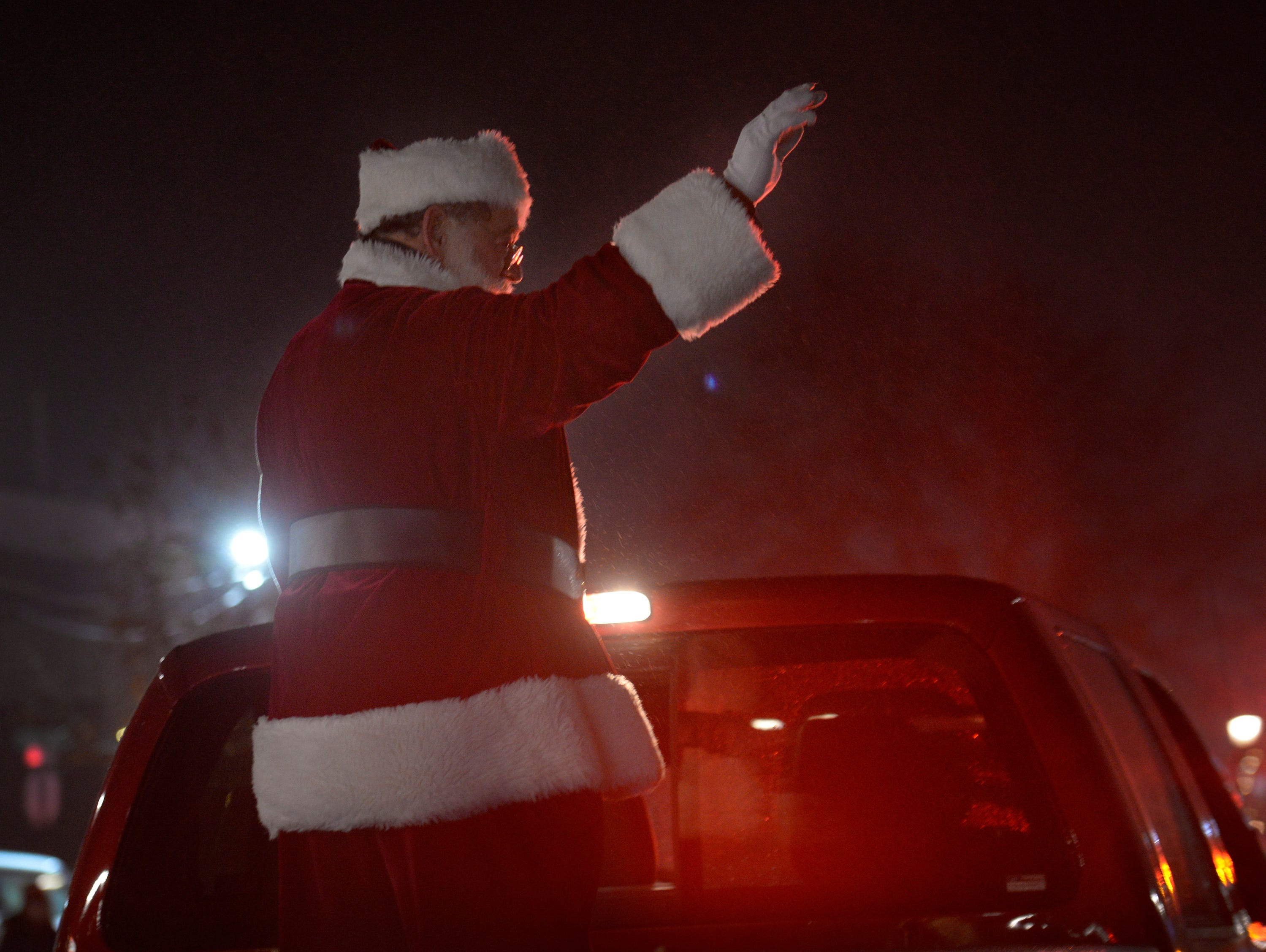 Santa makes his way down Lafayette Street during the Lighted Parade as part of South Lyon's Cool Yule celebration Dec. 1, 2018.