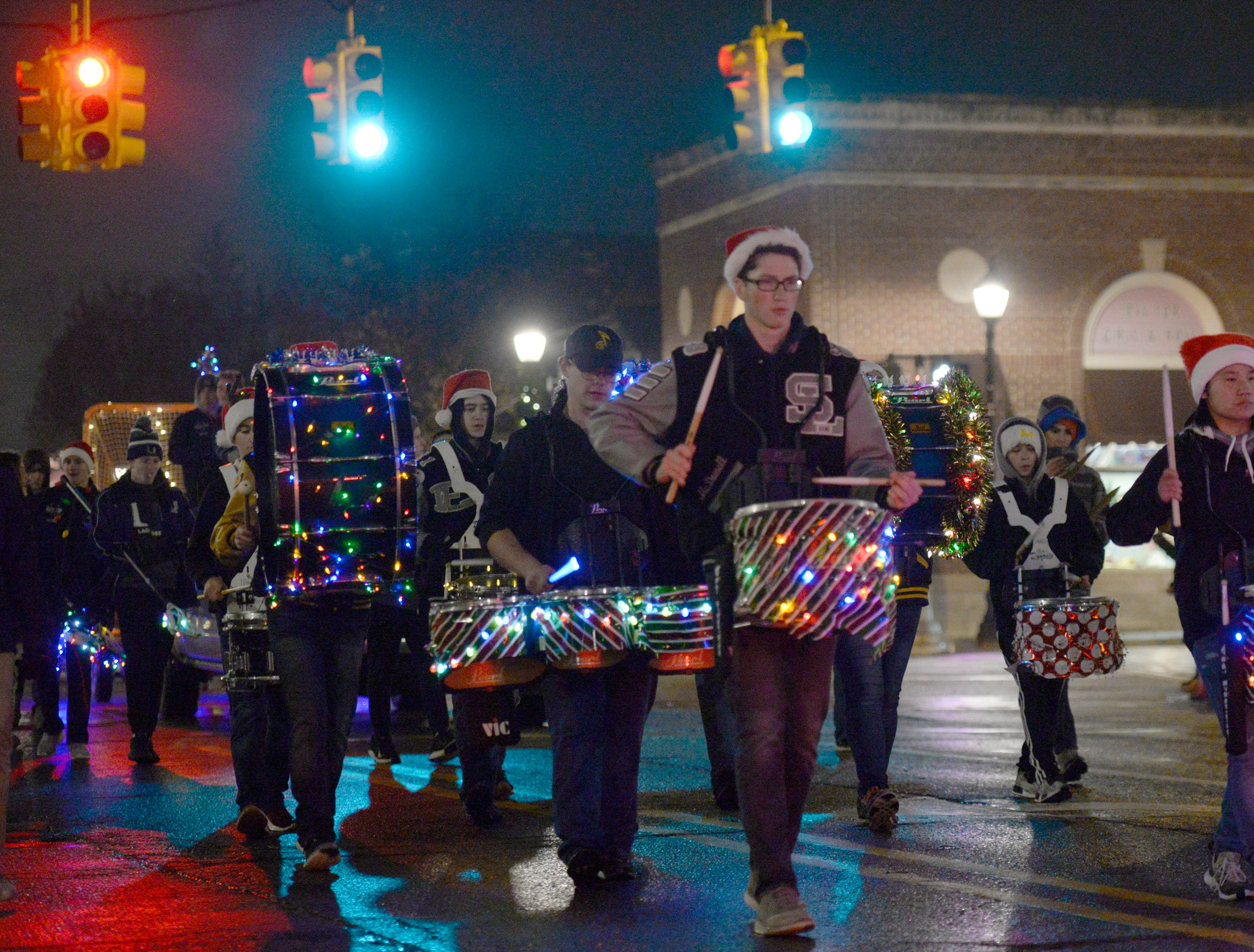 The South Lyon High School Marching Band in the Lighted Parade Dec. 1, 2018.