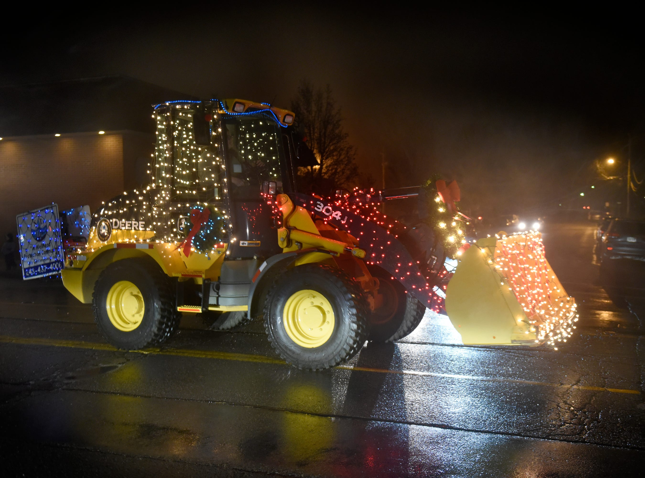 No parade is complete without big trucks. The Lighted Parade during South Lyon's Cool Yule celebration Dec. 1, 2018.