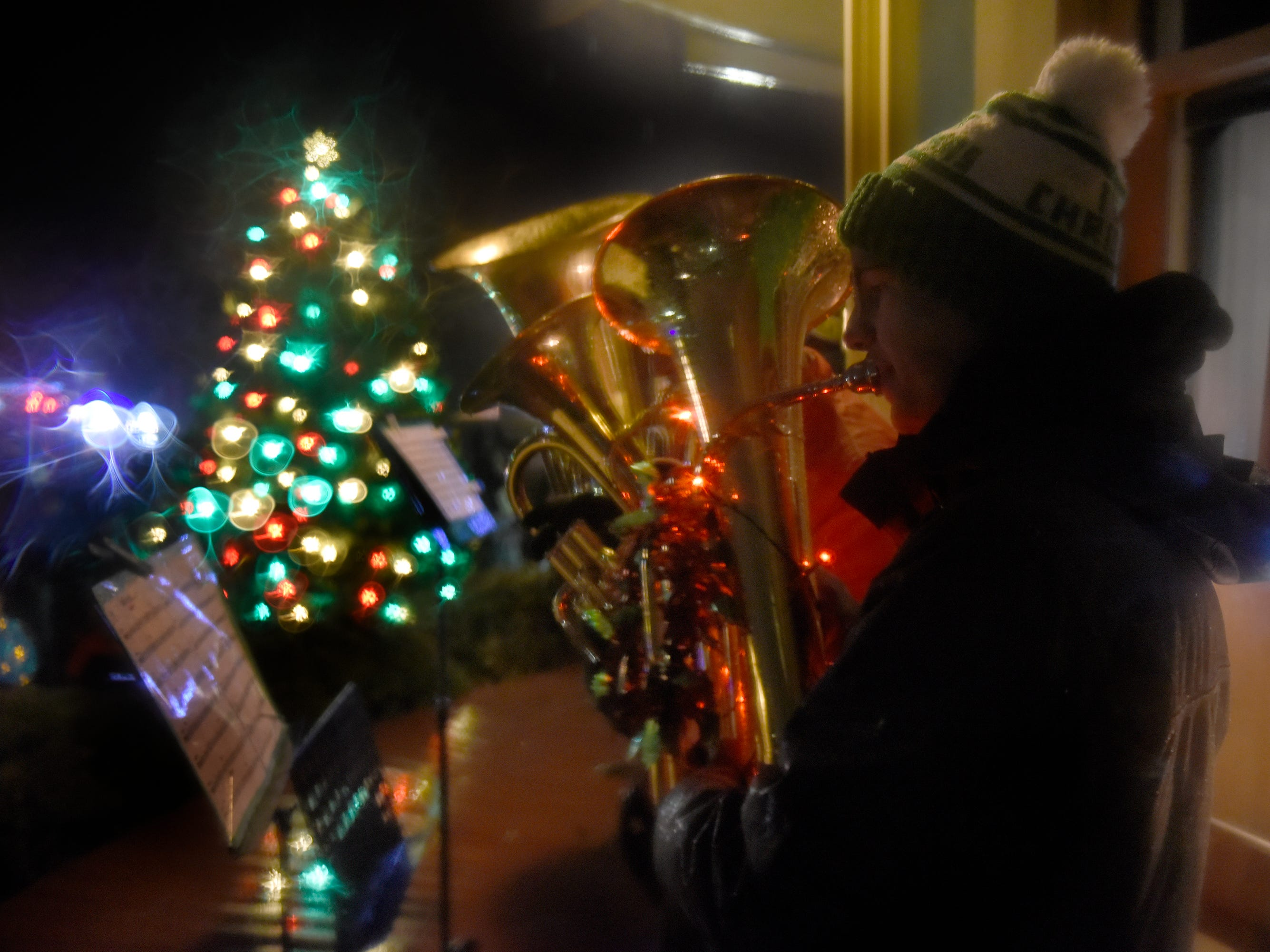 Carolers at the Witches Hat Depot tree lighting ceremony during South Lyon's Cool Yule celebration Dec. 1, 2018.