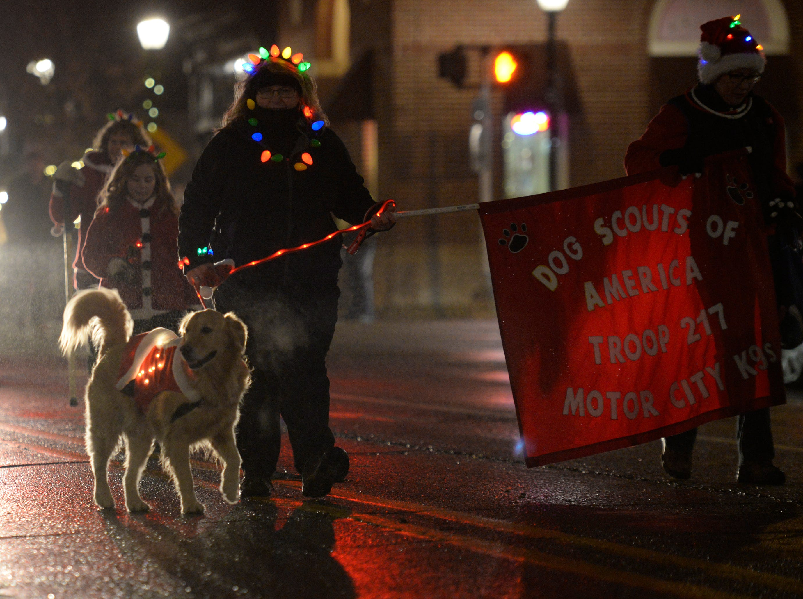 Dog Scouts of America in the Lighted Parade as part of the Cool Yule celebration Dec. 1, 2018.