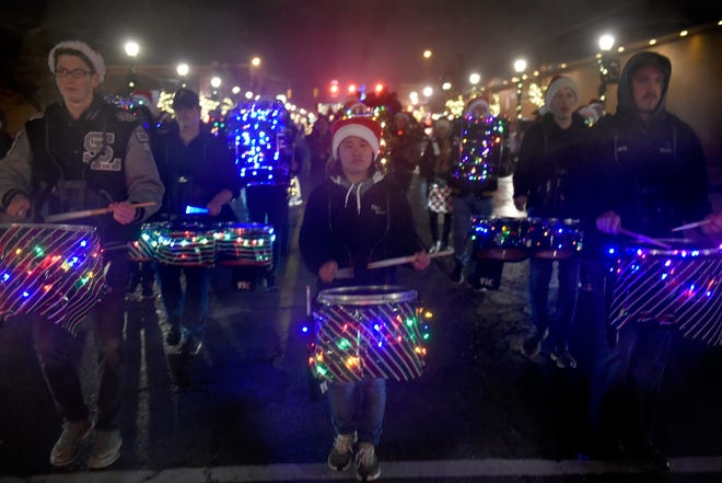 South Lyon High School Marching Band during South Lyon's Cool Yule Lighted Parade Dec. 1, 2018.